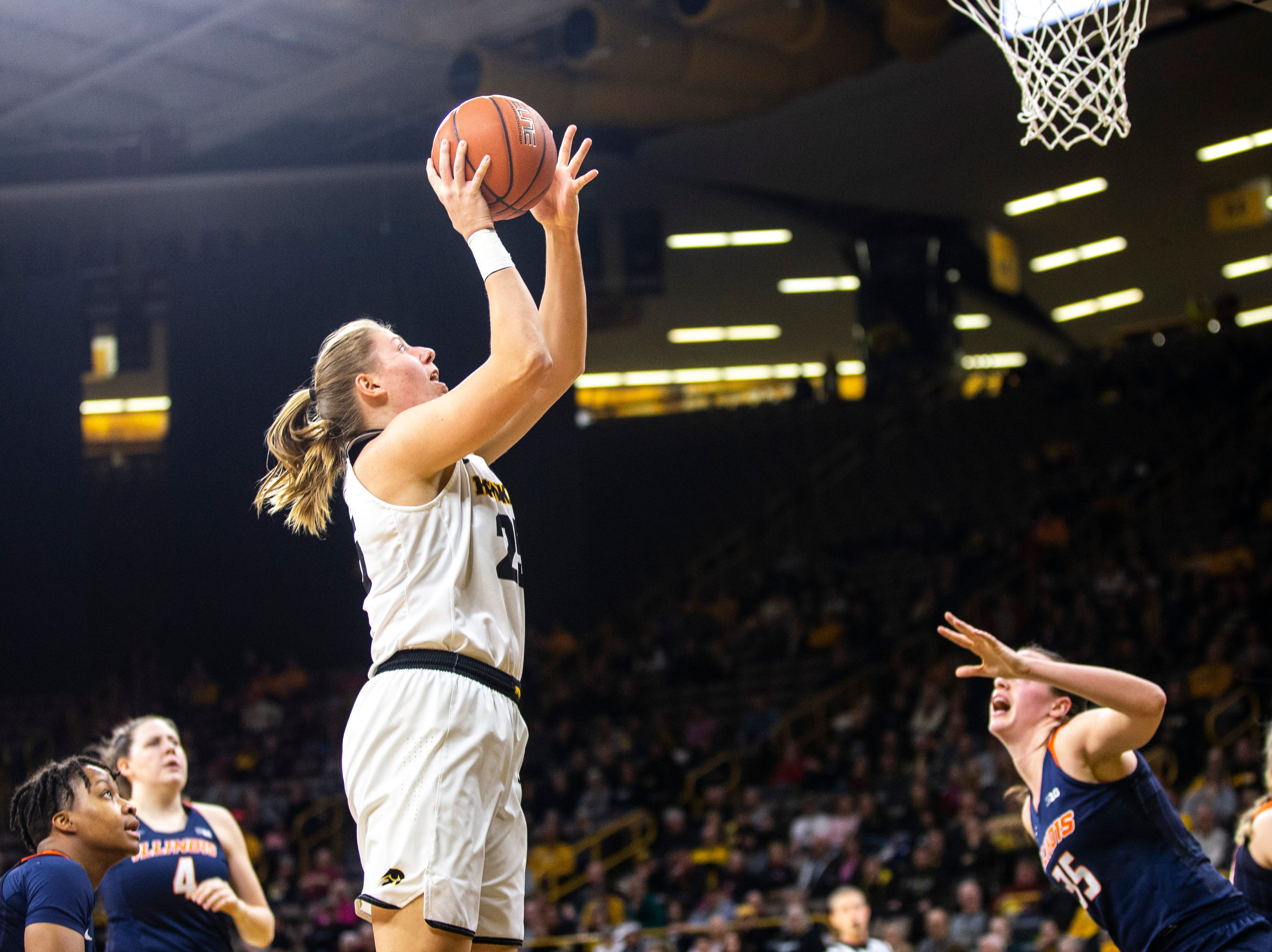 Iowa's Monika Czinano (25) attempts a basket during a NCAA Big Ten Conference women's basketball game on Thursday, Feb. 14, 2019 at Carver-Hawkeye Arena in Iowa City, Iowa.
