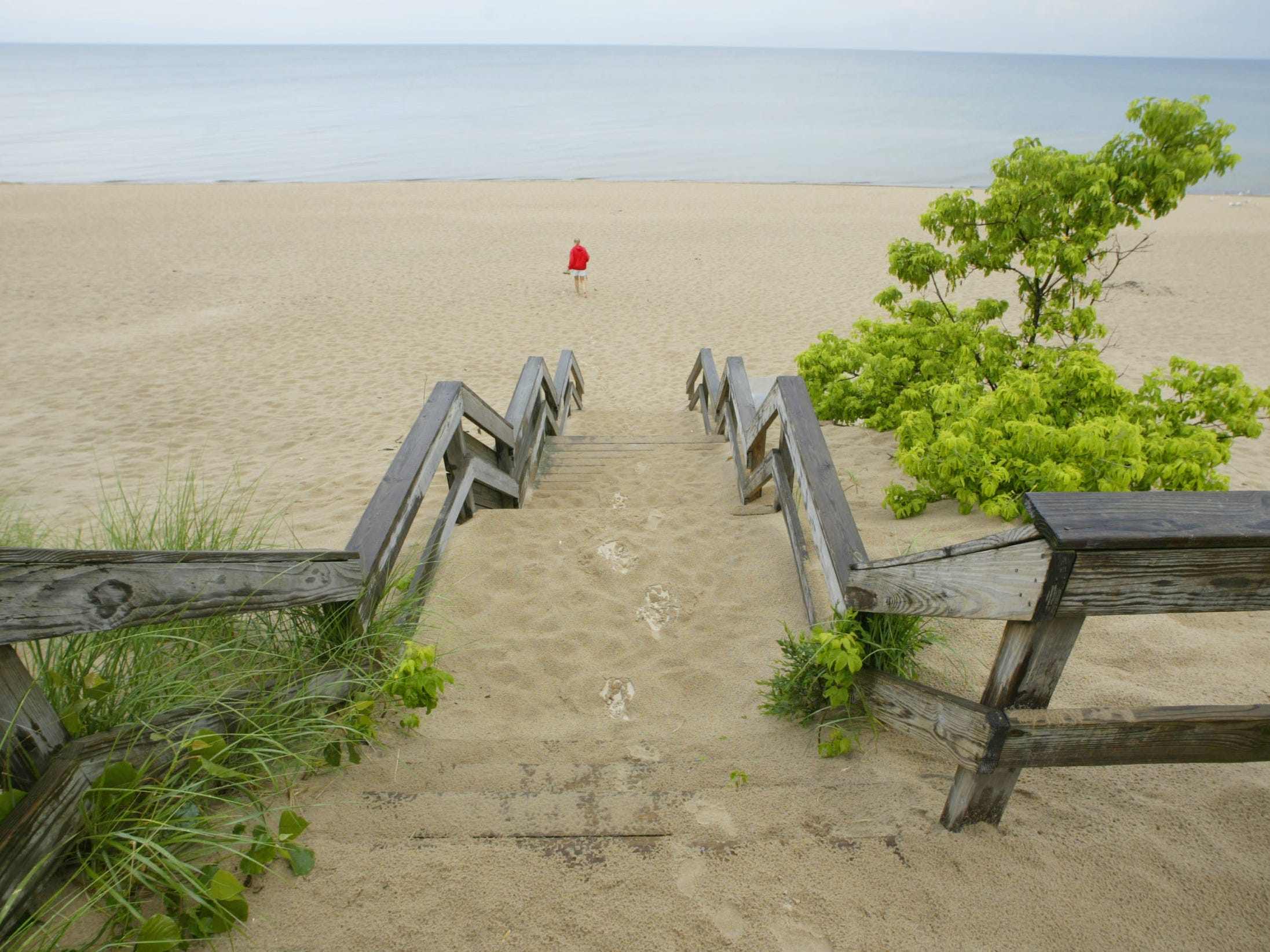 Wooden steps lead to Lakeview Beach and Lake Michigan at Indiana Dunes, near Beverly Shores, Indiana. President Donald Trump designation it the Indiana Dunes National Park.