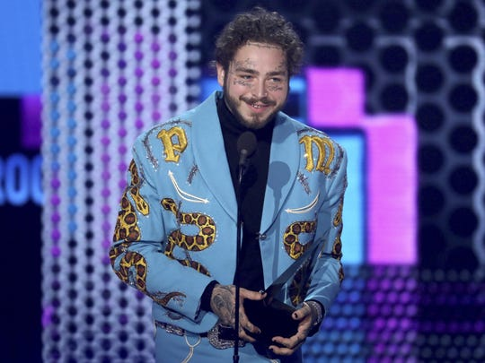 Post Malone wears a suit made by Indianapolis tailor Jerry Lee Atwood Oct. 9, 2018, at the American Music Awards.