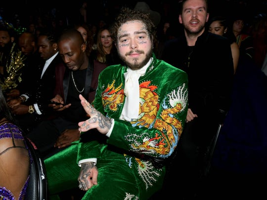 Post Malone wears a suit made by Indianapolis tailor Jerry Lee Atwood Feb. 10 at the Grammy Awards.