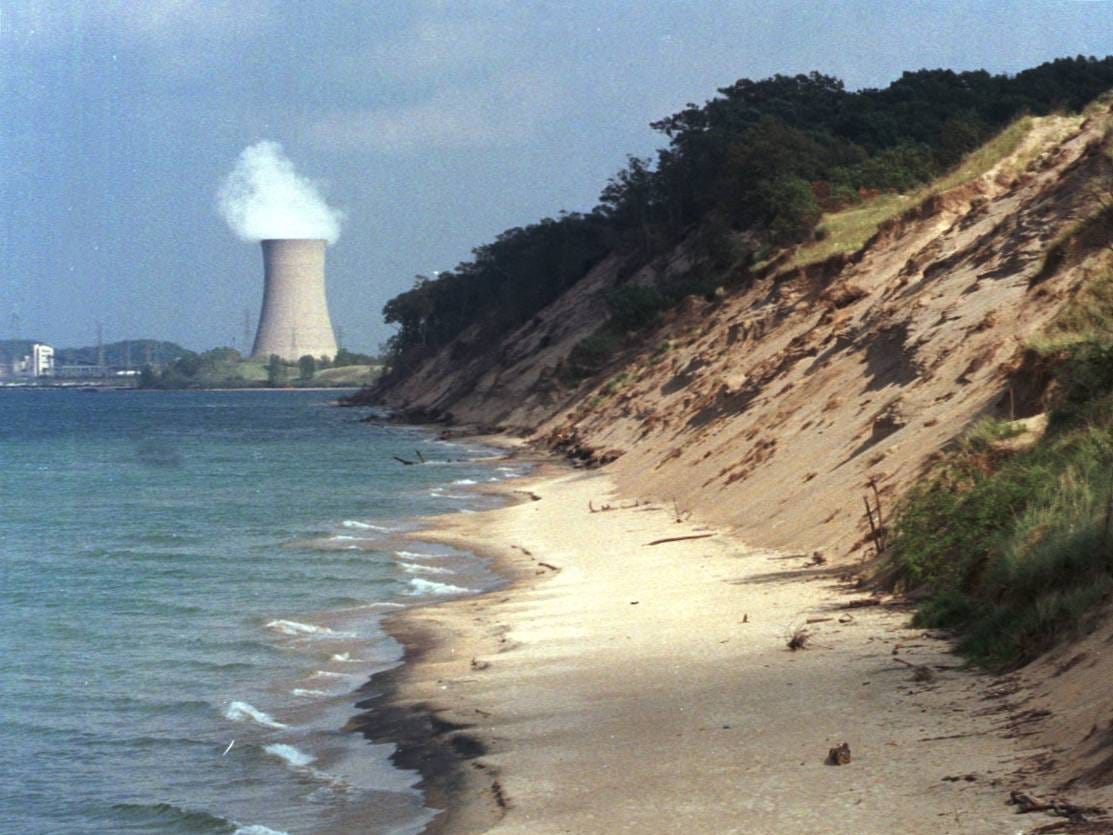 A view up the beach from Mount Baldy in the Indiana Dunes State Park shows a cooling tower at the NIPSCO (Northern Indiana Public Service Co.) plant in Michigan City.