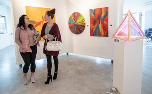 Rachel Rodriguez (left), Fishers, chats with Michelle Farley, Carmel, before a meeting of the National Association of Women Business Owners, at High Frequency Arts, a gallery in Fishers, Friday, Feb. 15, 2019. The space is one of just a couple of similar ones in the Hamilton County city that is quickly changing its landscape through new building projects.