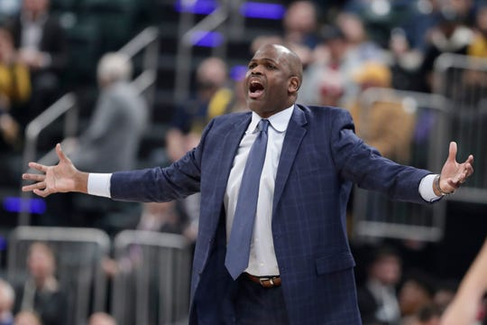 Pacers coach Nate McMillan questions a call during the first half of an NBA basketball game against the Sacramento Kings in Indianapolis.