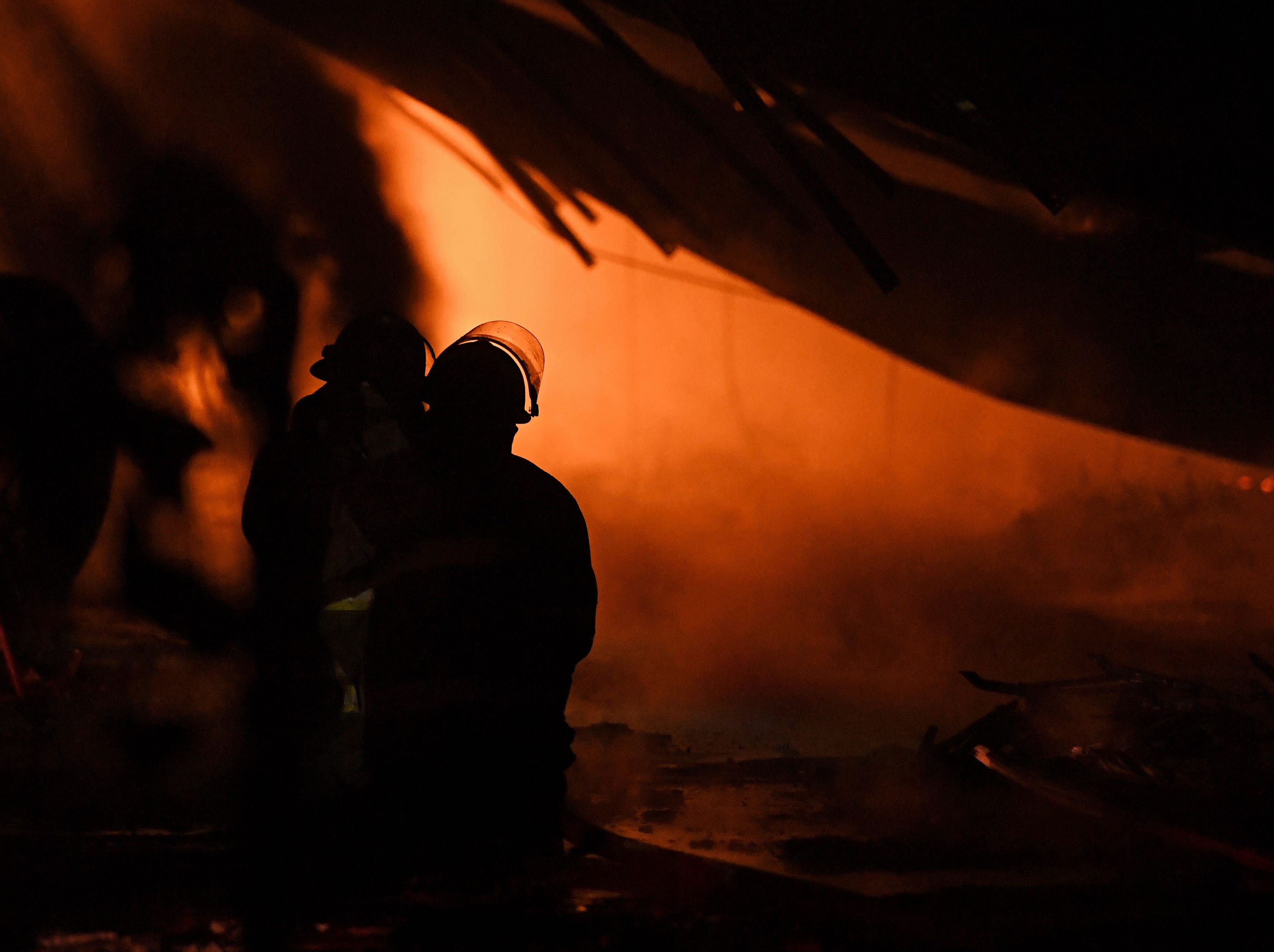 Firefighters work to extinguish a fire at American Furniture Manufacturing in Ecru, Miss., Thursday, Feb. 14, 2019. The fire was the third fire at the facility in just over one year and is still under investigation.