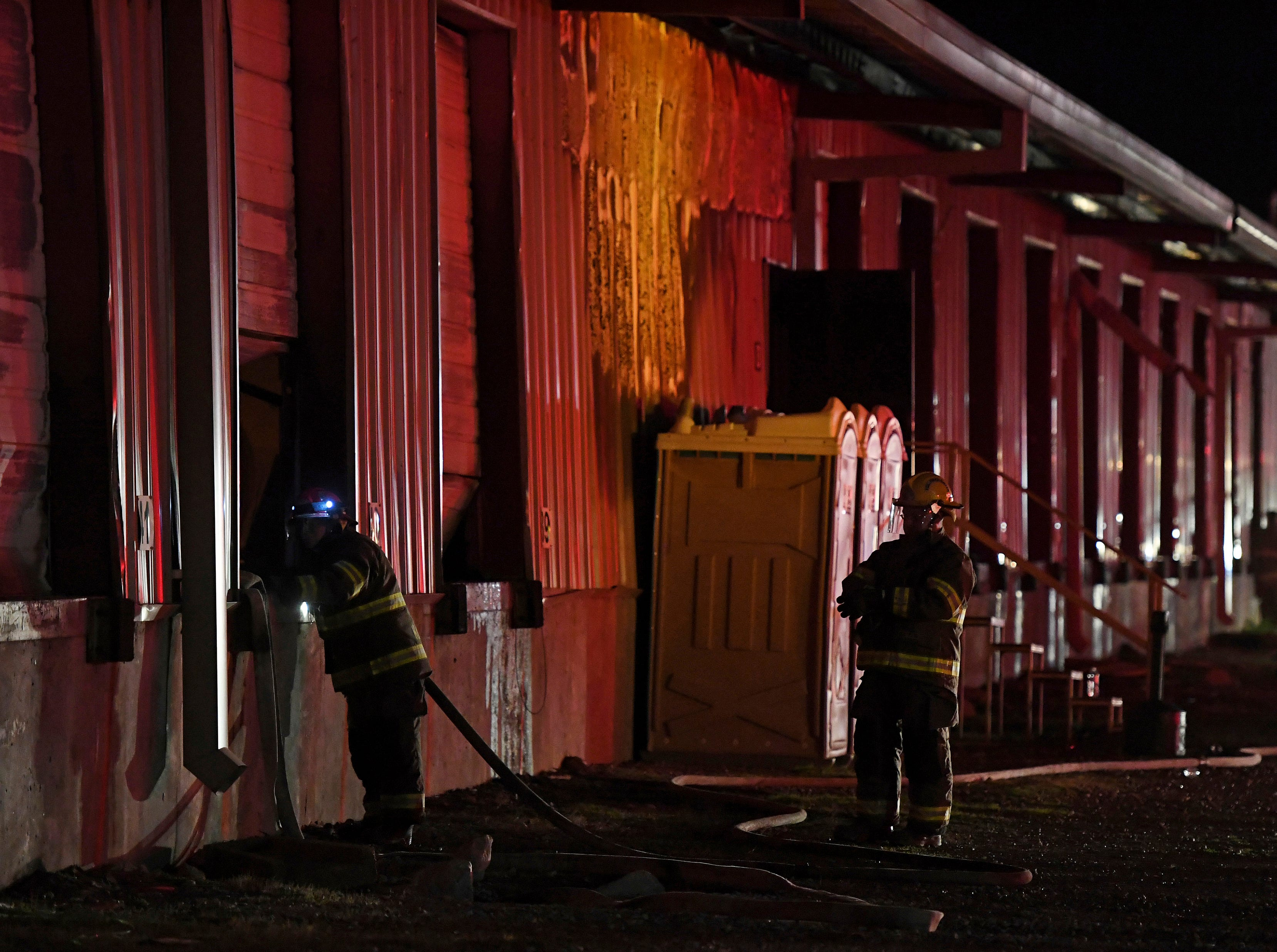 Firefighters work to extinguish a fire at American Furniture Manufacturing in Ecru, Miss., Thursday, Feb. 14, 2019.