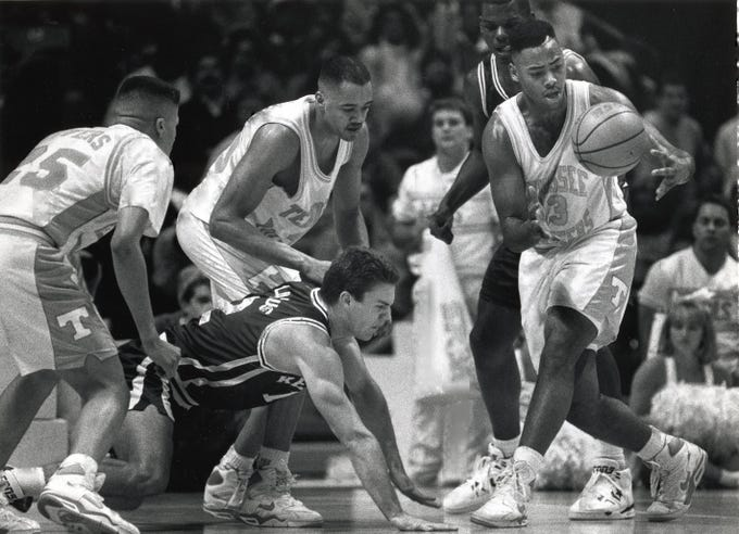 Tennessee's Carlos Groves (33) comes up with the loose ball as Kentucky's Deron Feldhaus (12) scrambles on the floor during a game in January 1992.