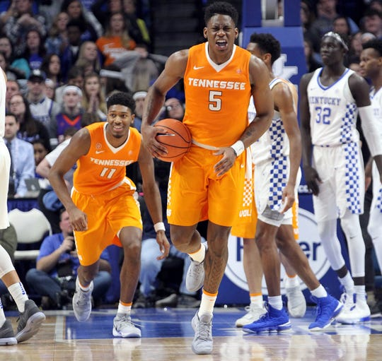 Tennessee's Admiral Schofield (5) and Kyle Alexander (11) celebrate after beating Kentucky 61-59 in Lexington on  Feb. 6, 2018.