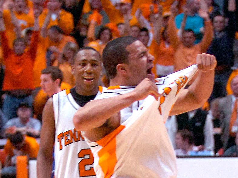 UT's Chris Lofton popss his jersey out to the crowd after the 89-85 win over Kentucky at Thompson Boling Arena in February 2007.
