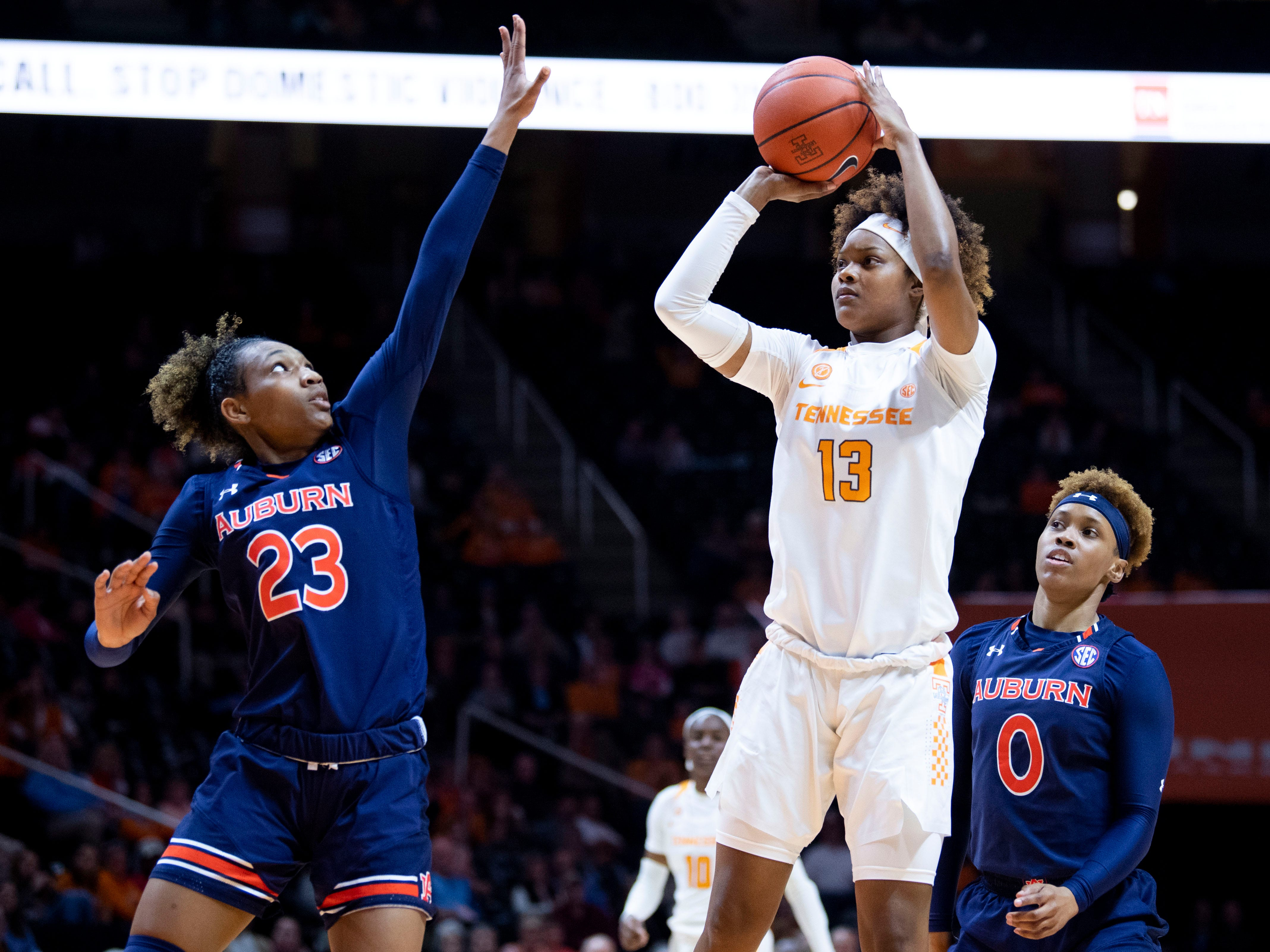 Tennessee's Jazmine Massengill (13) attempts to score while defended by Auburn's Crystal Primm (23) on Thursday, February 14, 2019.