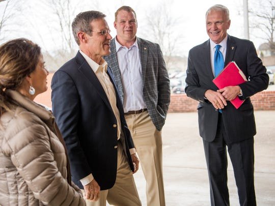 Tennessee Gov. Bill Lee, second from left, is greeted by Knox County Mayor Glenn Jacobs, center, and Knox County Schools Superintendent Bob Thomas, right, at South-Doyle High in South Knoxville on Feb. 15, 2019.