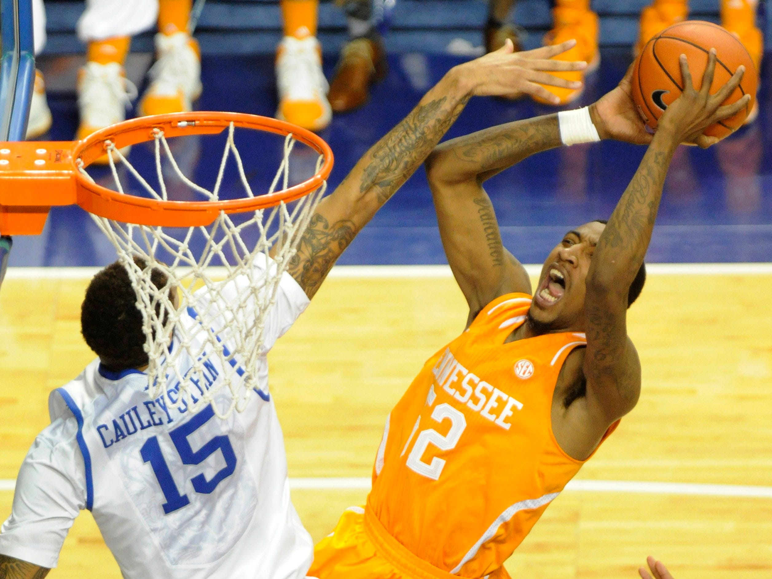 Kentucky forward Willie Cauley-Stein (15) attempts to block a layup by Tennessee guard Jordan McRae (52) during the second half at University of Kentucky's Rupp Arena in Lexington on Saturday, Jan. 18, 2014. Tennessee lost 74-66.