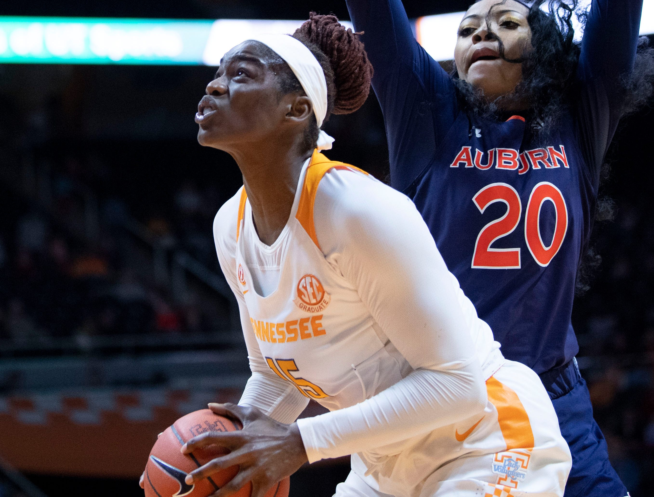 Tennessee's Cheridene Green (15) looks for the shot while guarded by Auburn's Unique Thompson (20) on Thursday, February 14, 2019.