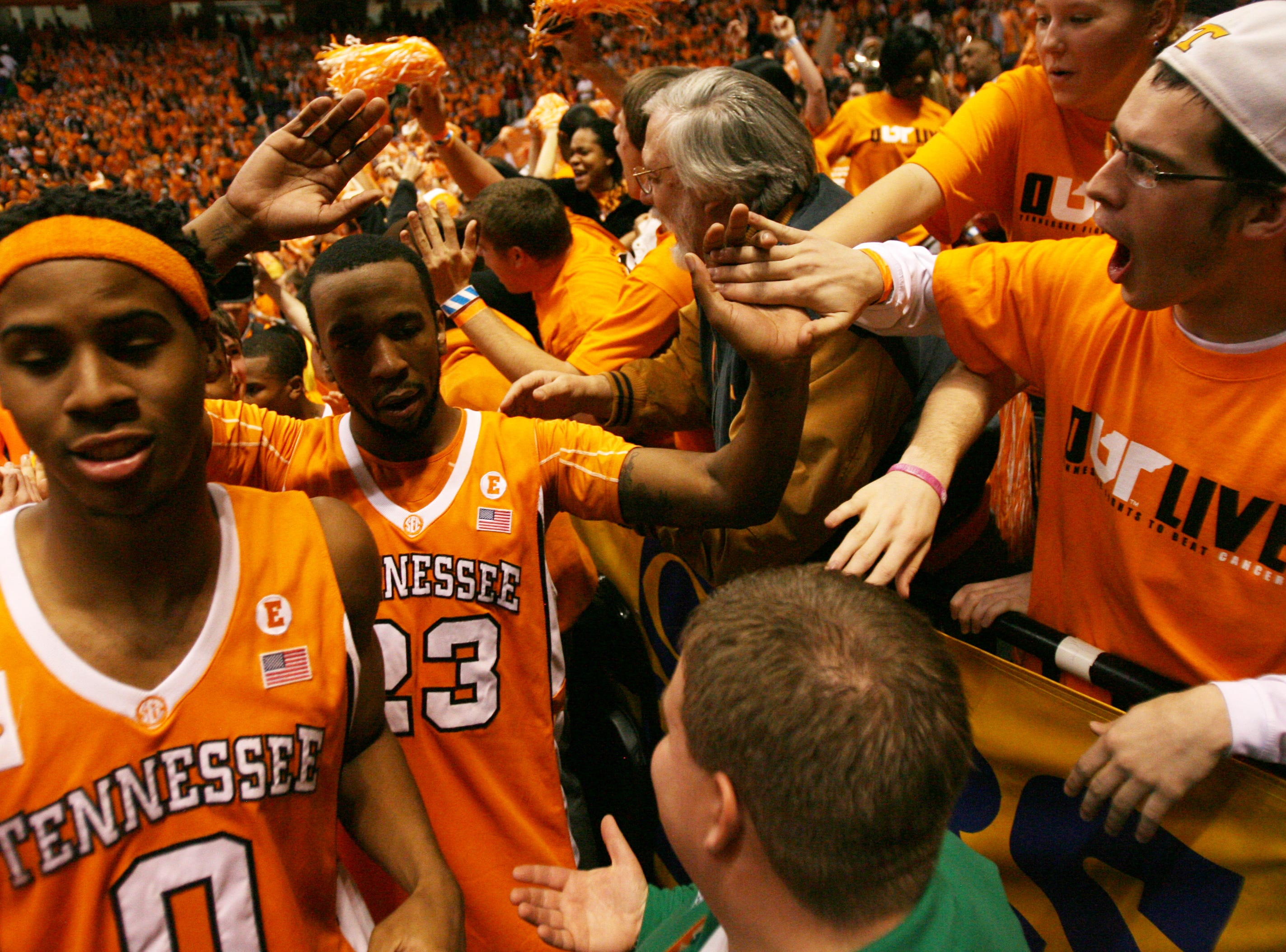 Tennessee fans celebrate with Renaldo Woolridge, left, and Cameron Tatum, center, after the Vols defeated the Kentucky Wildcats 74-65 at Thompson-Boling Arena Saturday, Feb. 27, 2010.