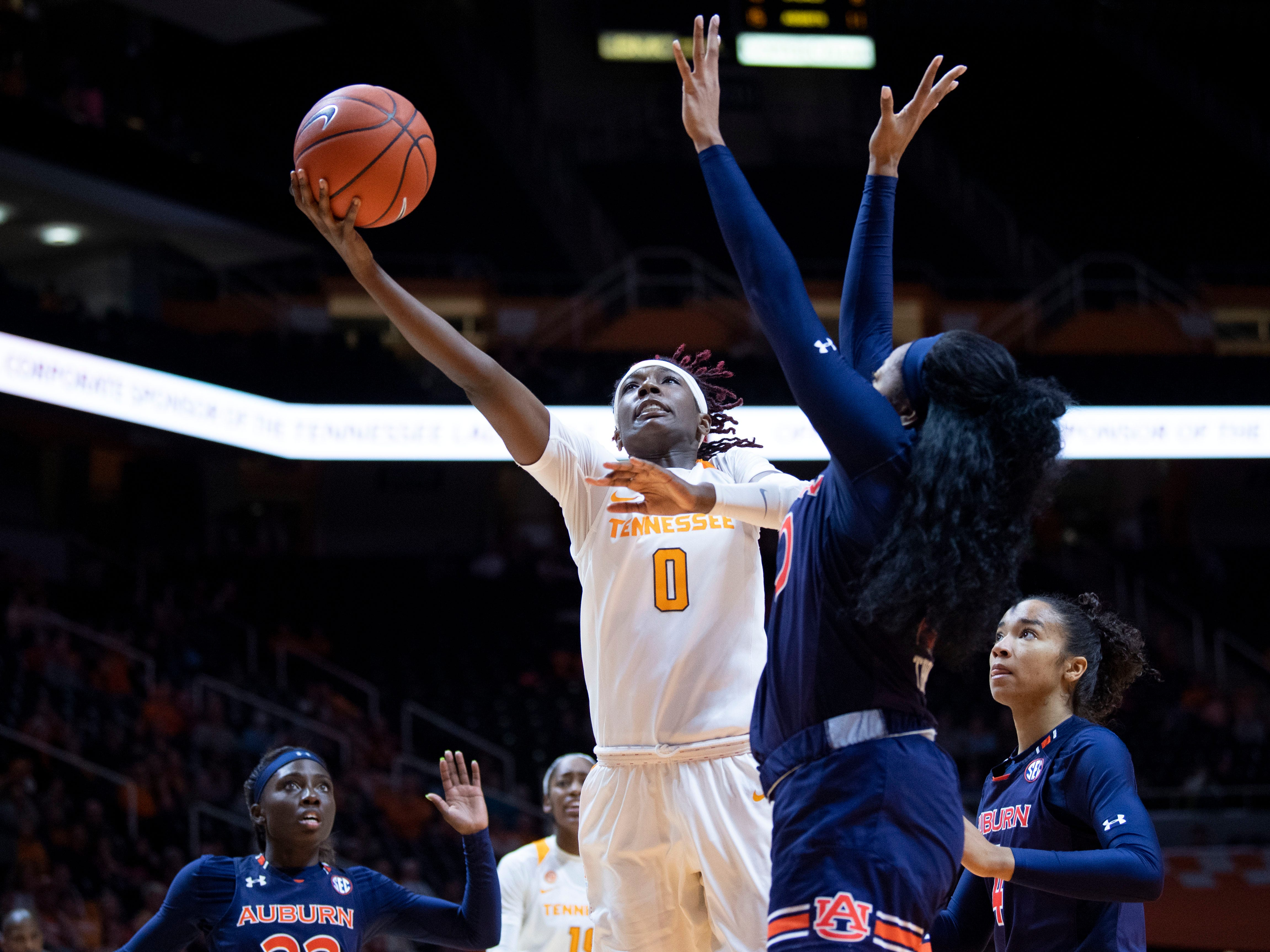 Tennessee's Rennia Davis (0) takes a shot while guaded by Auburn's Unique Thompson (20) on Thursday, February 14, 2019.