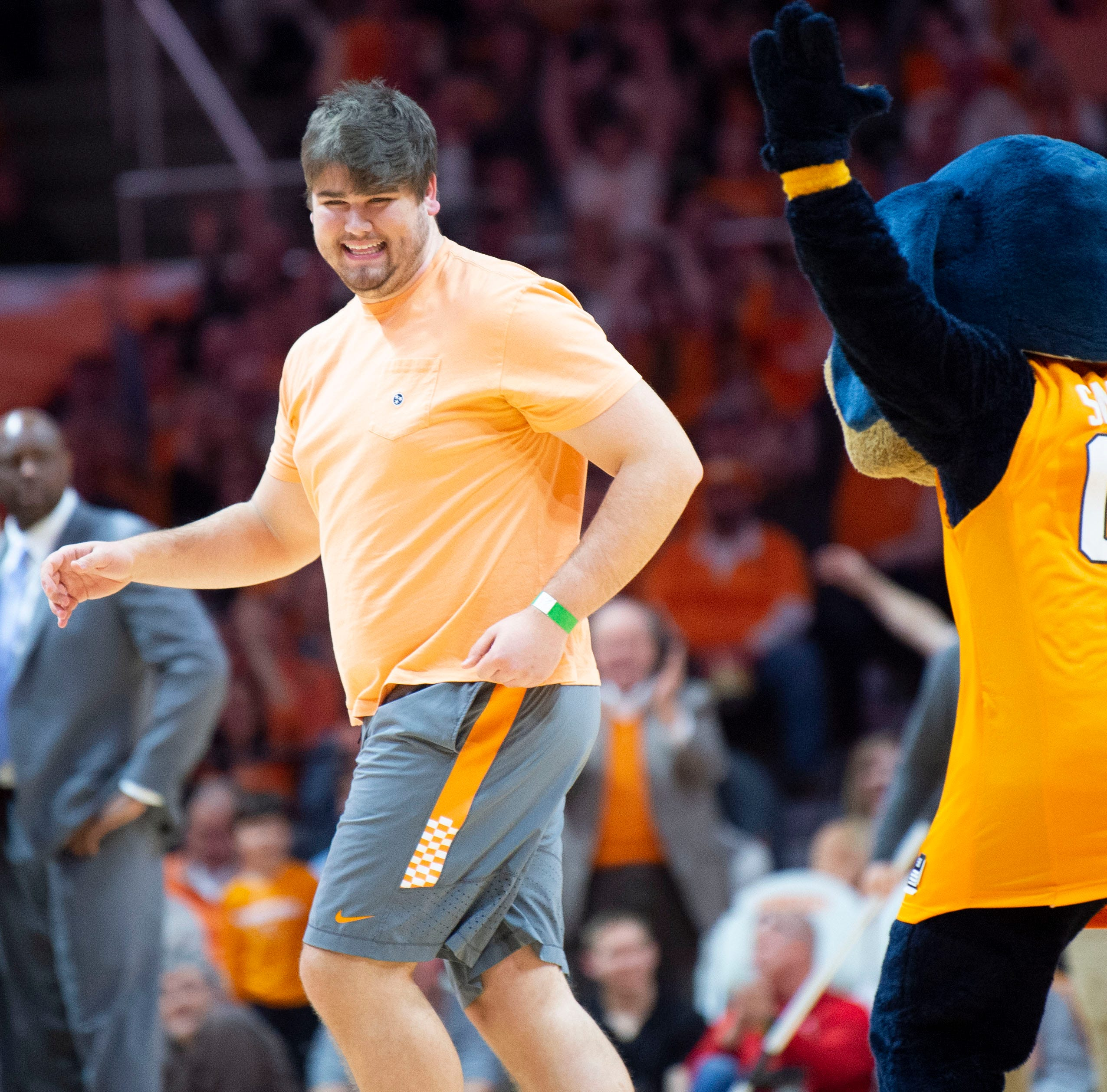 Former Vol lineman basks in the glory of his half-court shot. Watch!