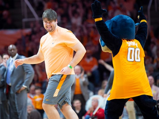 University of Tennessee student Clay Keaton is congratulated by Smokey after Keaton hit a basket from half court during a promotion at the Tennessee basketball game against South Carolina on Wednesday, February 13, 2019.
