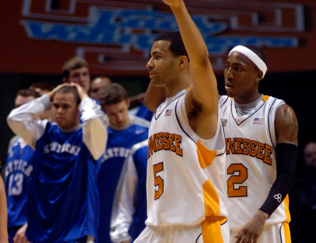 Tennessee's Christ Lofton and JaJuan Smith make their way to the bench after defeating Kentucky 63-60 in March 2007 at Thompson-Boling Arena.