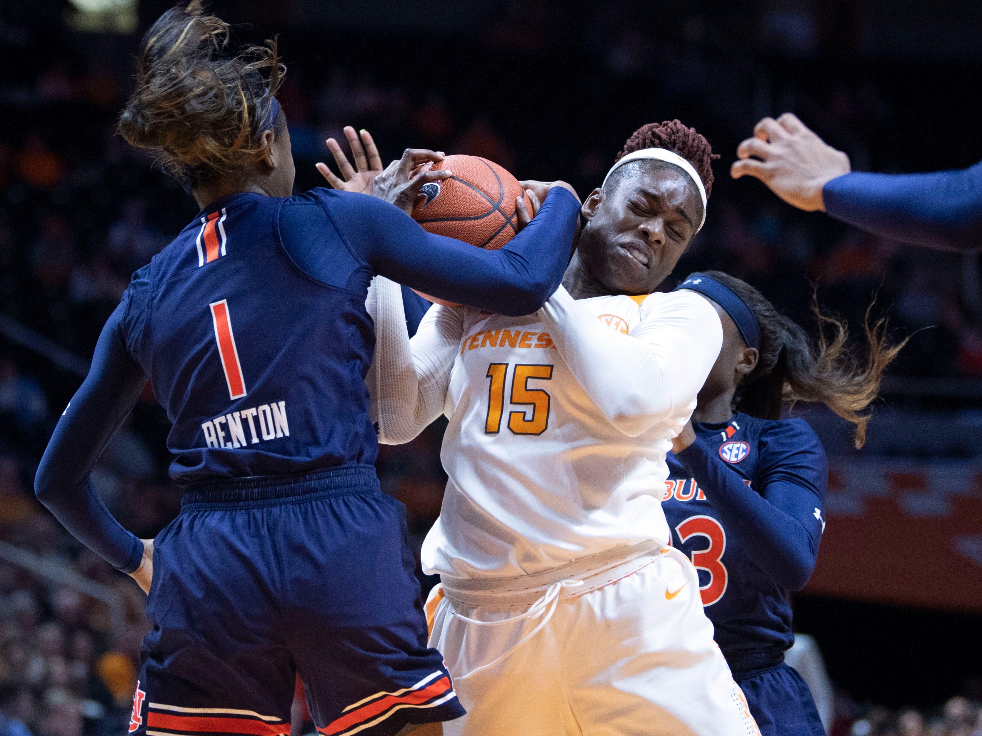 Tennessee's Cheridene Green (15) fights Auburn's Robyn Benton (1) for the ball on Thursday, February 14, 2019.