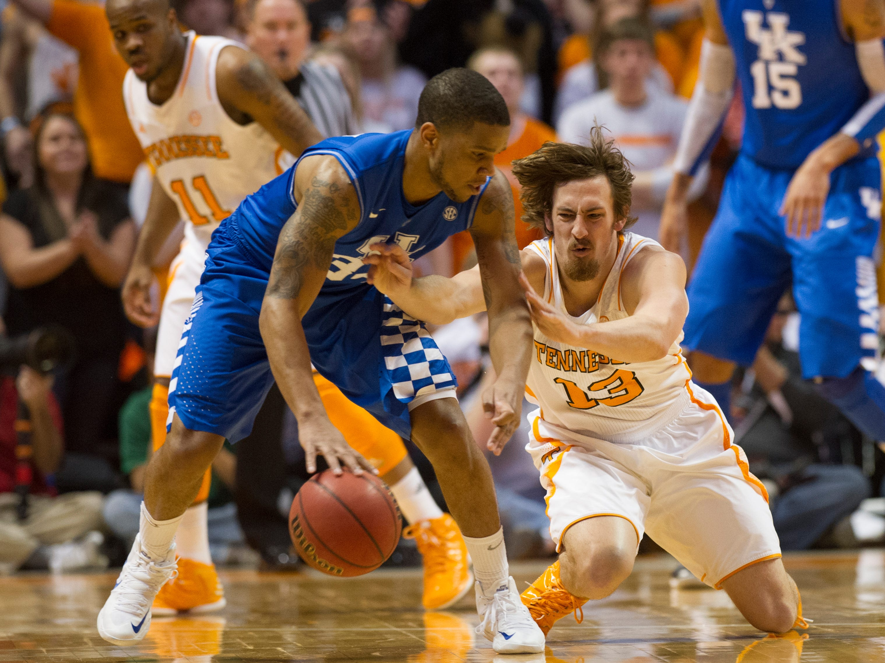 Kentucky guard Julius Mays (34) handles the ball as Tennessee guard Skylar McBee (13) takes a dive during the first half at Thompson-Boling Arena Saturday, Feb. 16, 2013.