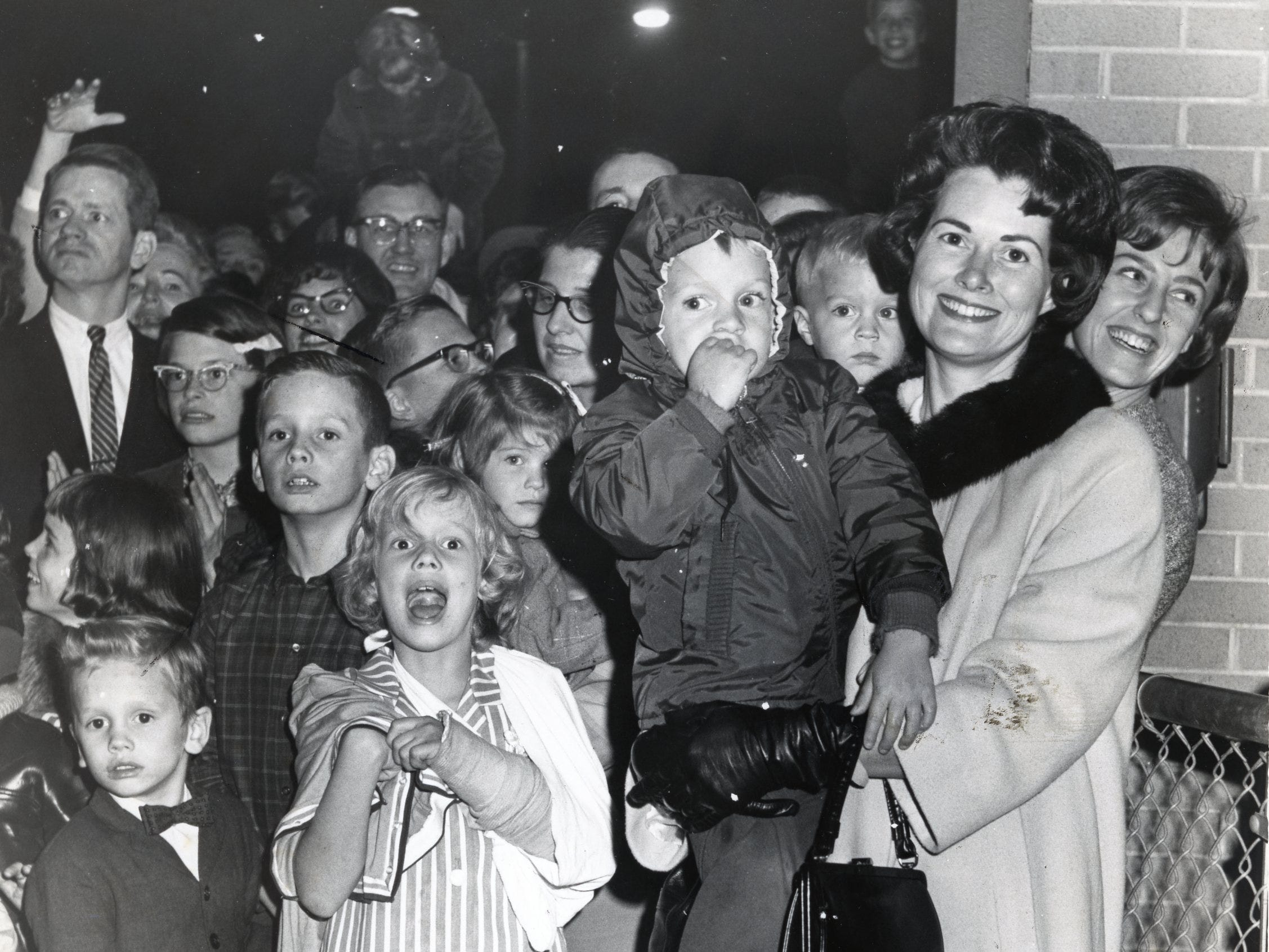 JoAnne Dickey, right holding child, in an October, 1964 photo.