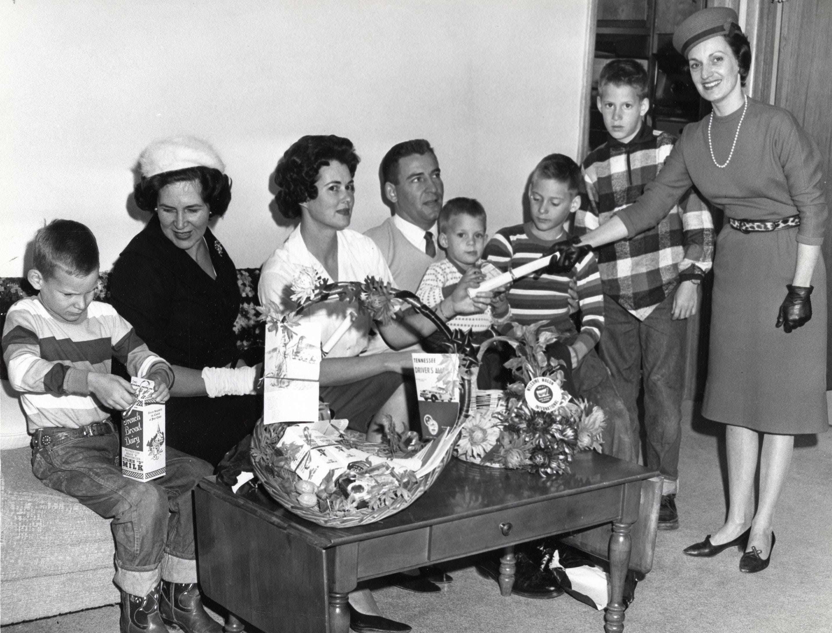 The Welcome Wagon calls on Doug Dickey and family in January, 1964. Pictured are David Dickey, Betty Scott, JoAnne Dickey, Doug Dickey, Daryl Dickey, Dan Dickey, Don Dickey and Sara Ann Oakley. Scott and Oakley are with the Welcome Wagon.