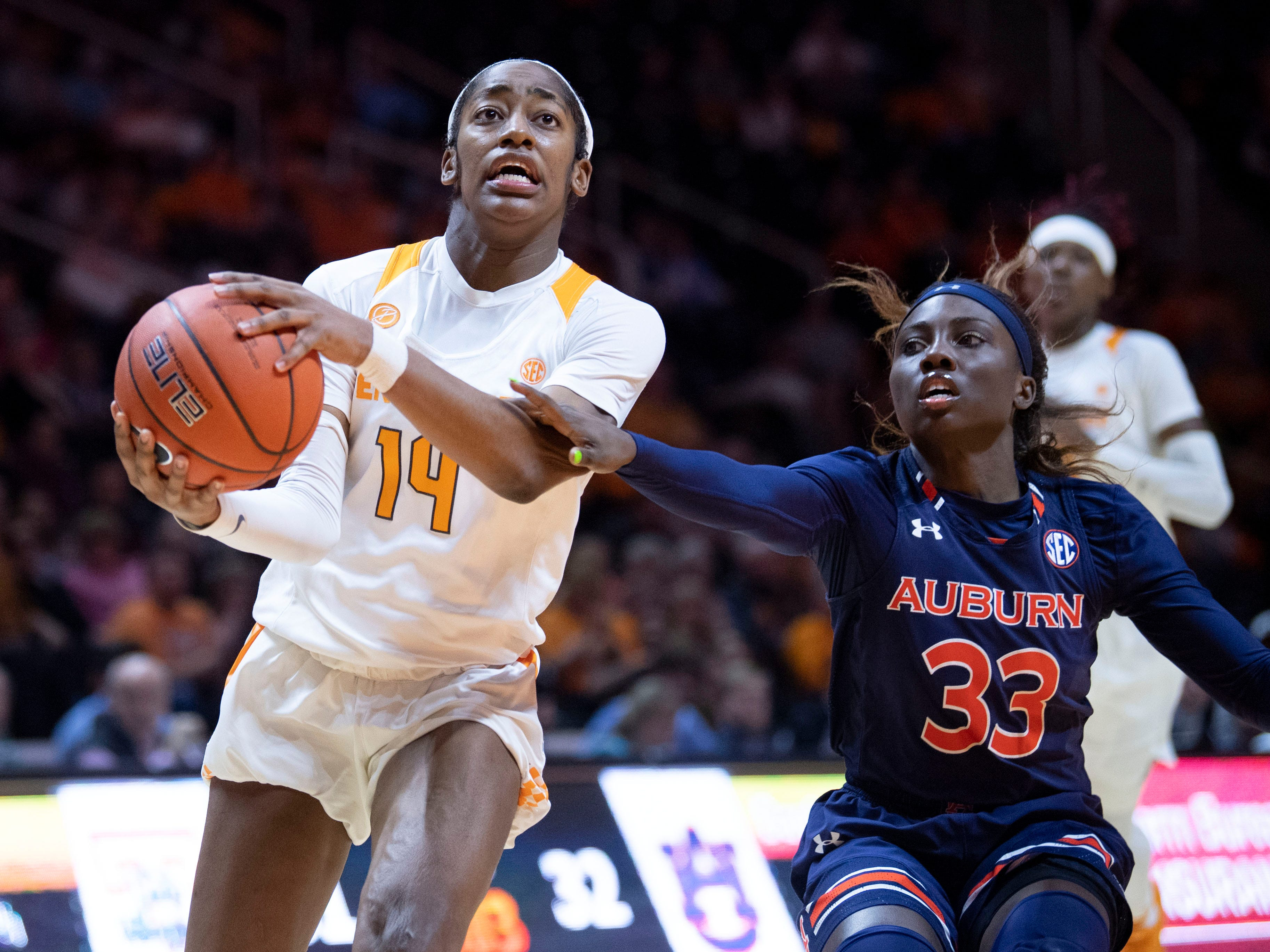 Tennessee's Zaay Green (14) drives towards the basket while guarded by Auburn's Janiah McKay (33) on Thursday, February 14, 2019.