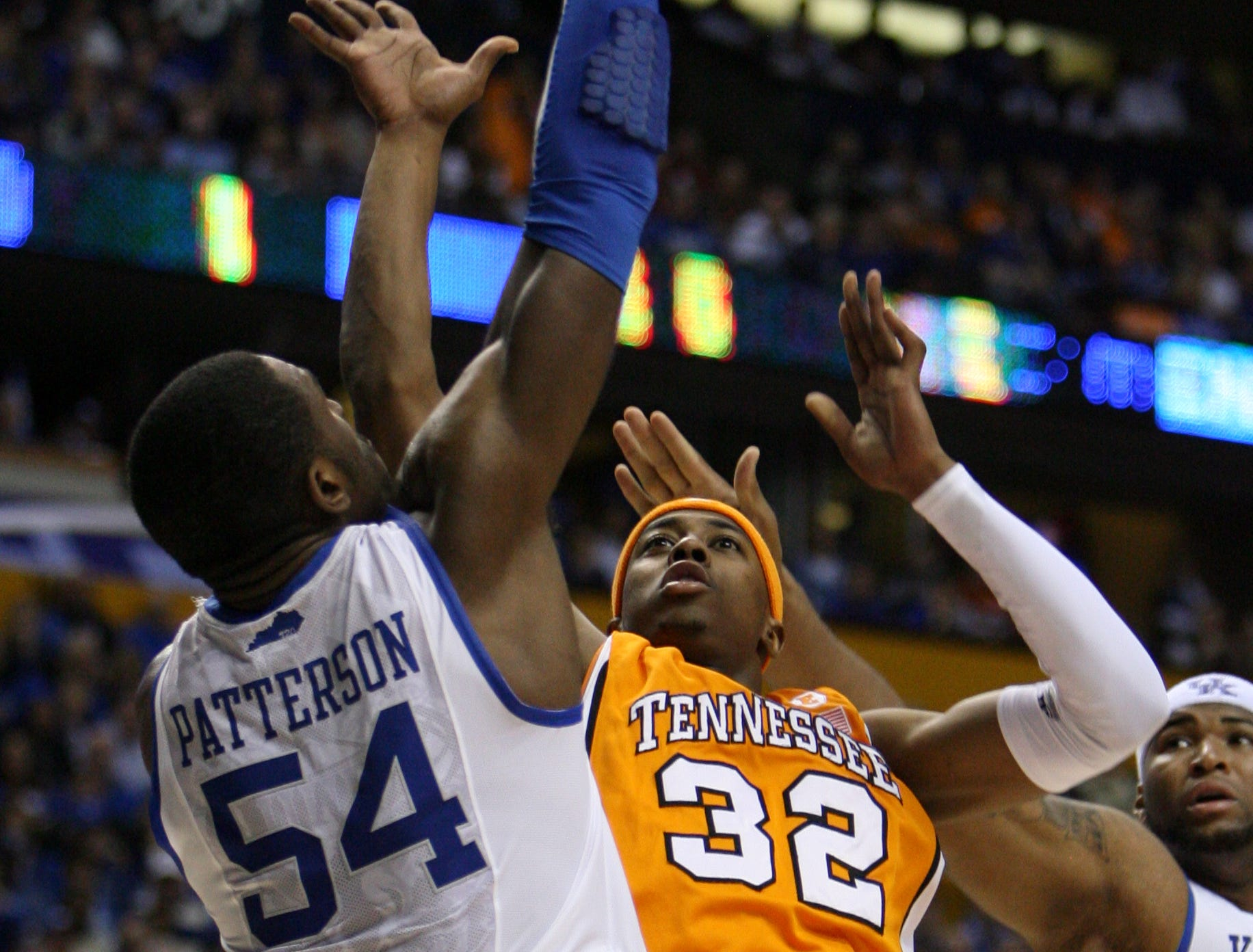 Tennessee's Scotty Hopson shoots as Kentucky's Patrick Patterson towers over him during the SEC Men's Basketball Tournament at Bridgestone Arena in Nashville Saturday, Mar. 13, 2010.