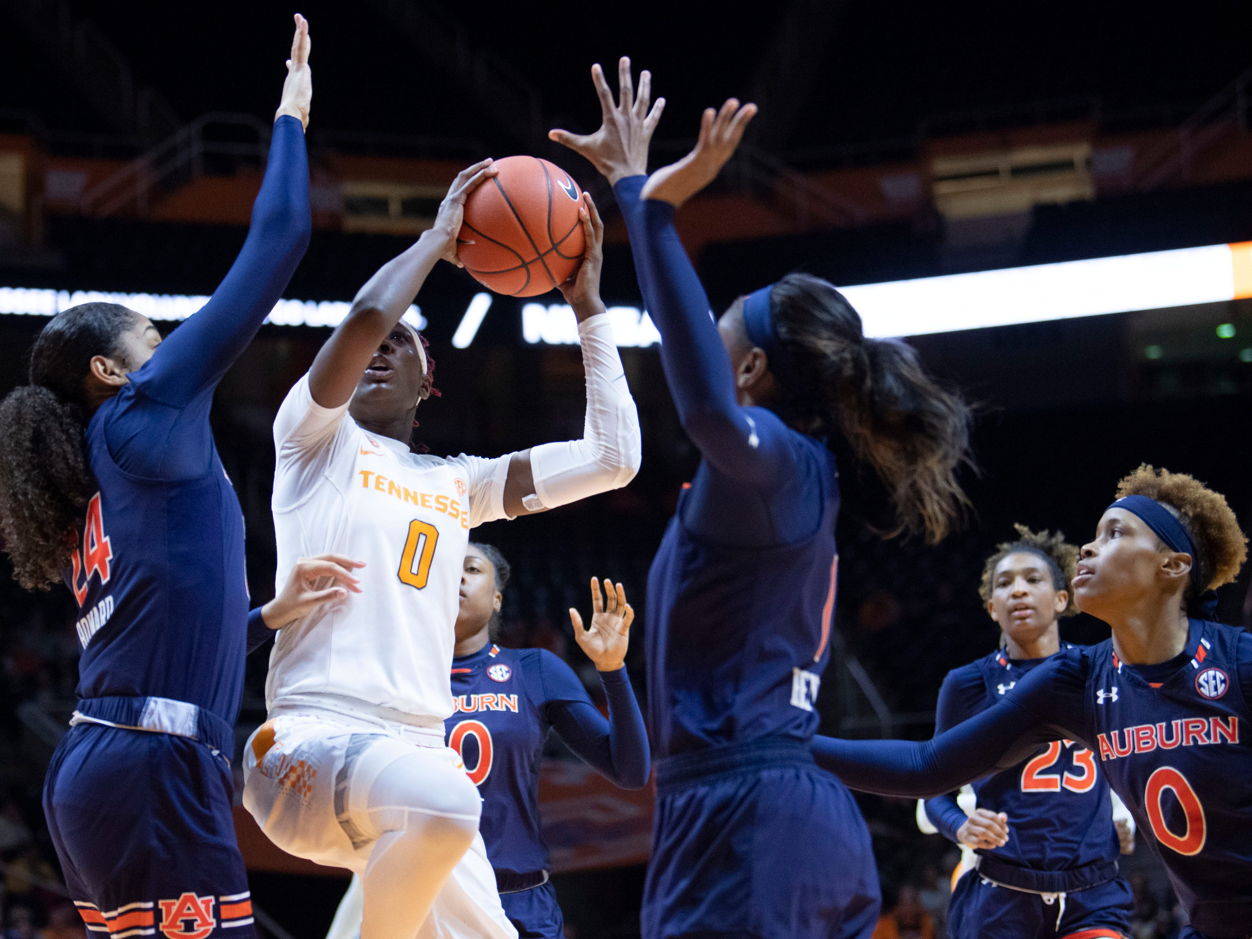 Tennessee's Rennia Davis (0) makes a shot attempt while surrounded by Auburn defenders on Thursday, February 14, 2019.