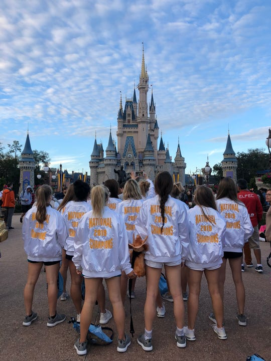 Wearing their championship jackets, the Farragut High School dance team celebrates their second straight national title for small varsity jazz in Orlando, Fla.