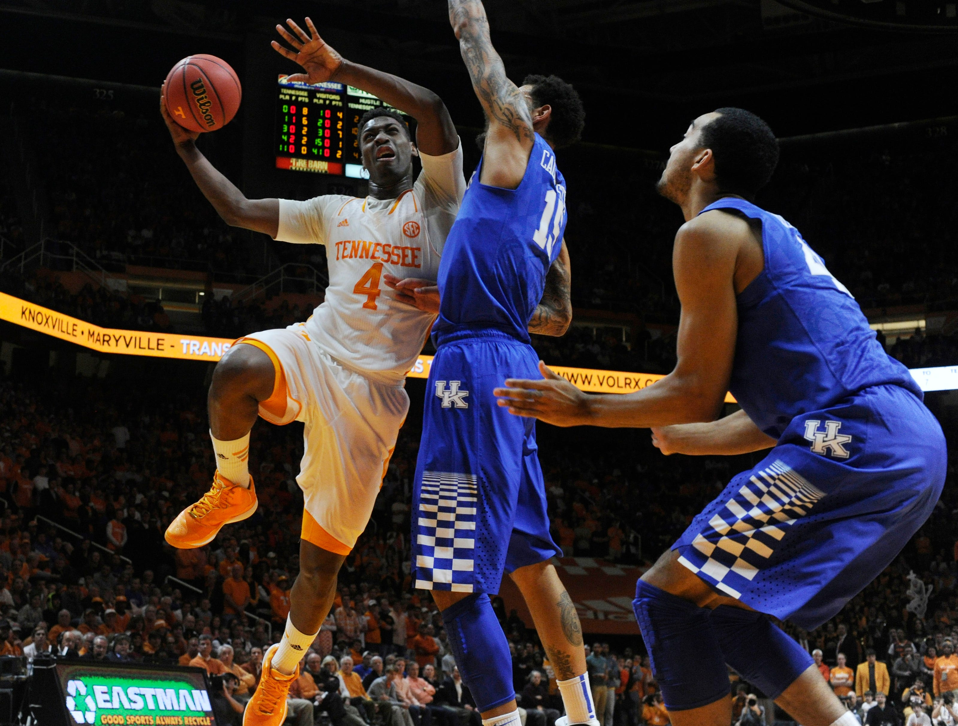 Tennessee guard Armani Moore (4) drives to the basket against Kentucky guard Willie Cauley-Stein (15) during the first half at Thompson-Boling Arena in Knoxville on Tuesday, Feb. 17, 2015.