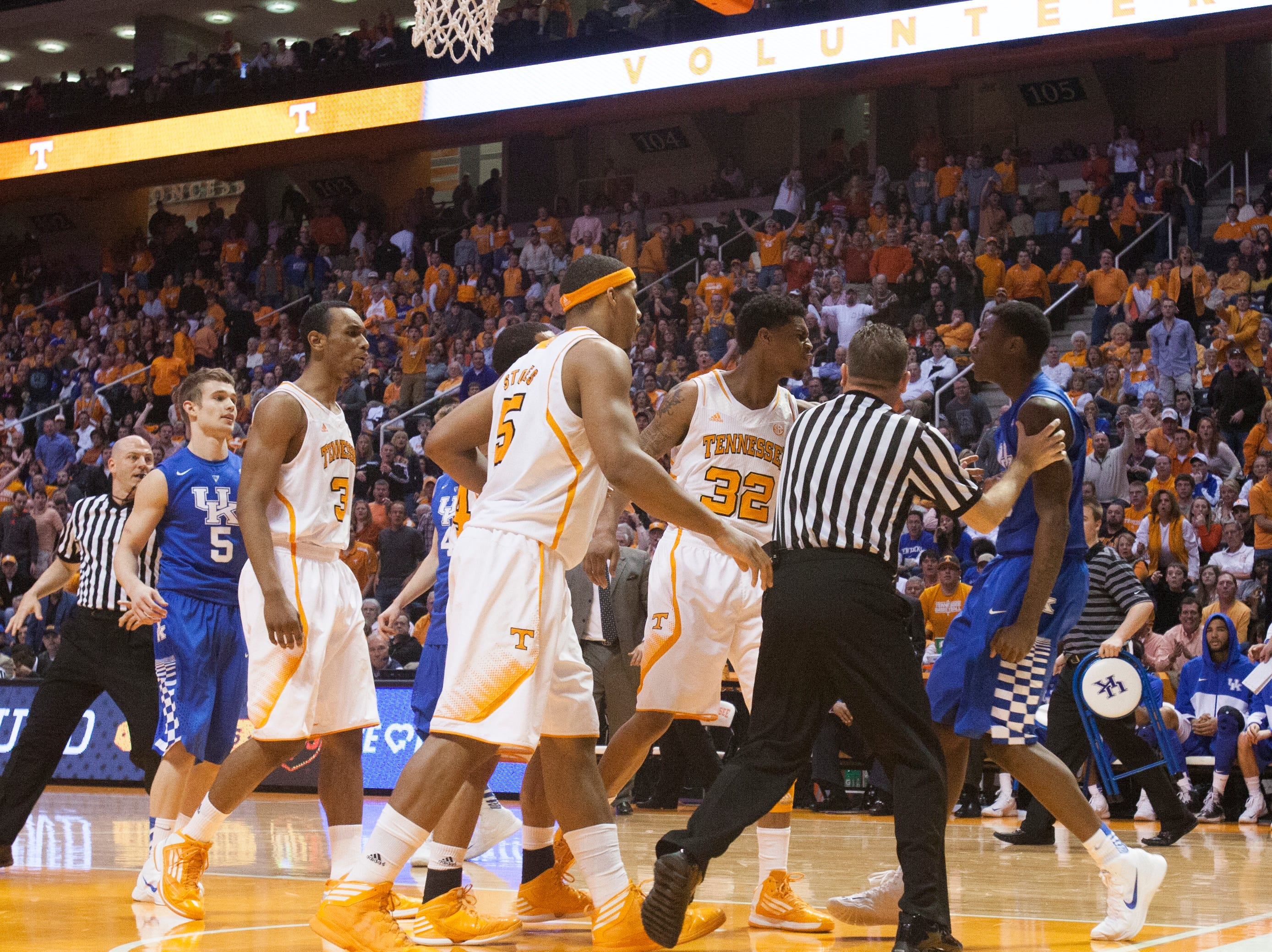 Tennessee guard D'Montre Edwards (32) and Kentucky guard Archie Goodwin (10) exchange words during the second half at Thompson-Boling Arena Saturday, Feb. 16, 2013. A technical foul was called on Goodwin and Tennessee's Brandon Lopez after the exchange. Tennessee won 88-58 over Kentucky.