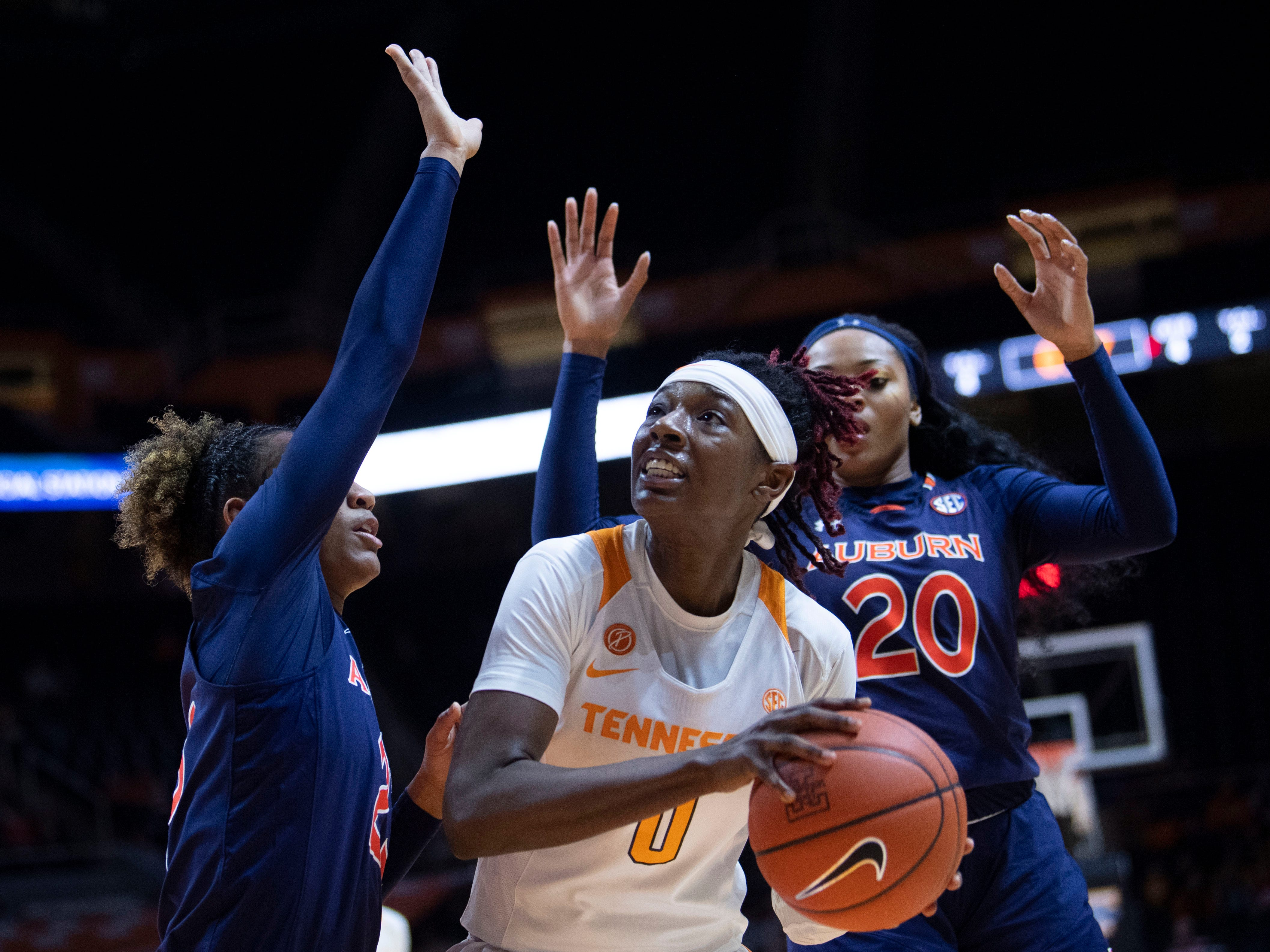 Tennessee's Rennia Davis (0) looks for an open shot while guarded by Auburn's Crystal Primm (23) and Unique Thompson (20) on Thursday, February 14, 2019.