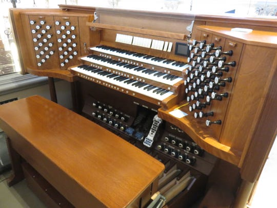Casavant organ console sits in rear balcony of Sacred Heart Cathedral off Northshore Drive.