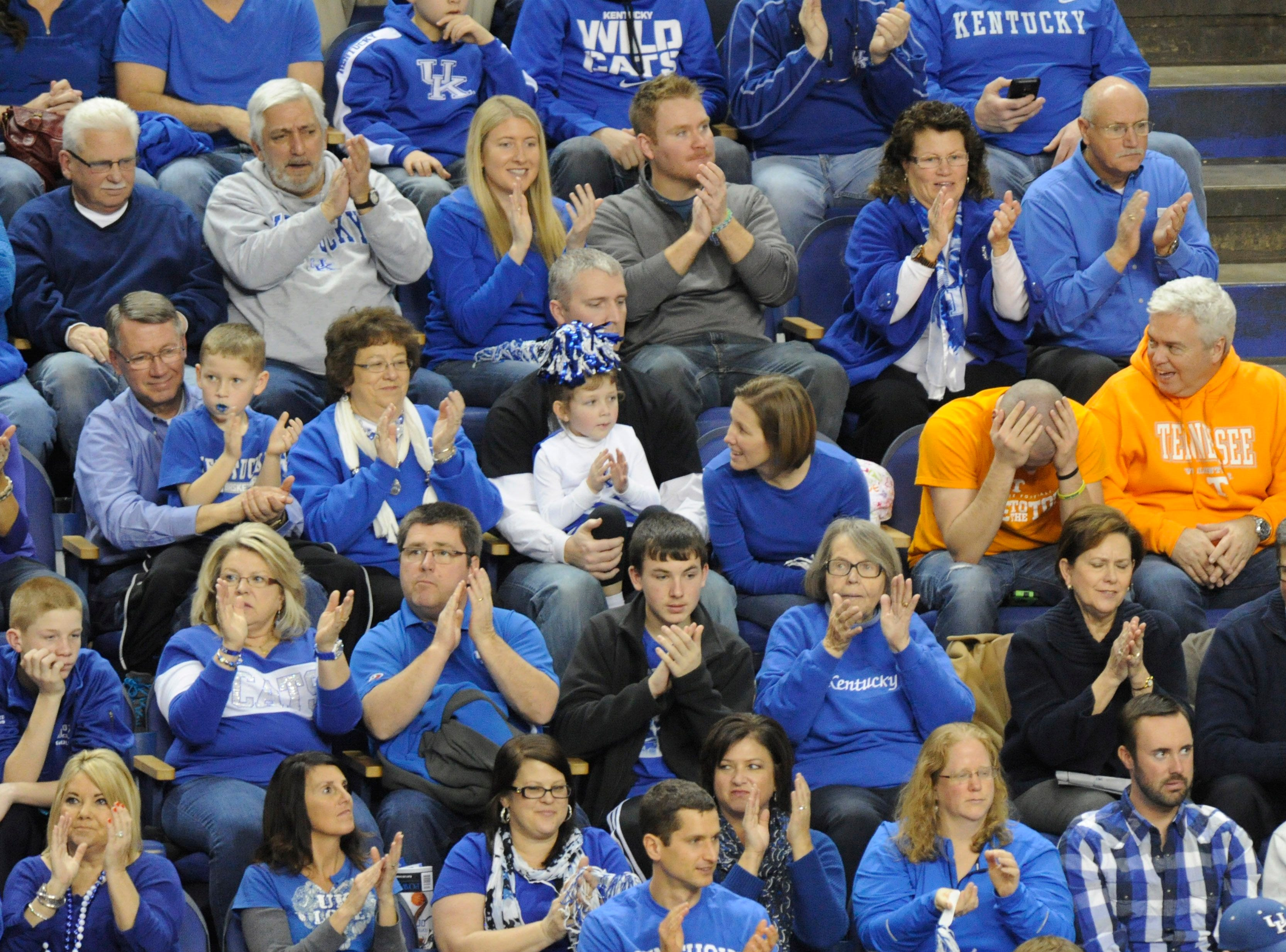 A Tennessee fan hold his head in his hands among a sea of Big Blue Kentucky fans during the second half at University of Kentucky's Rupp Arena in Lexington on Saturday, Jan. 18, 2014. Tennessee lost 74-66.