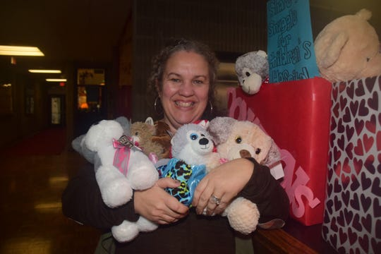 Byington Solway teacher Wendy Erwin with an armload of stuffed animals collected during a toy drive to benefit sick kids at East Tennessee Children's Hospital.