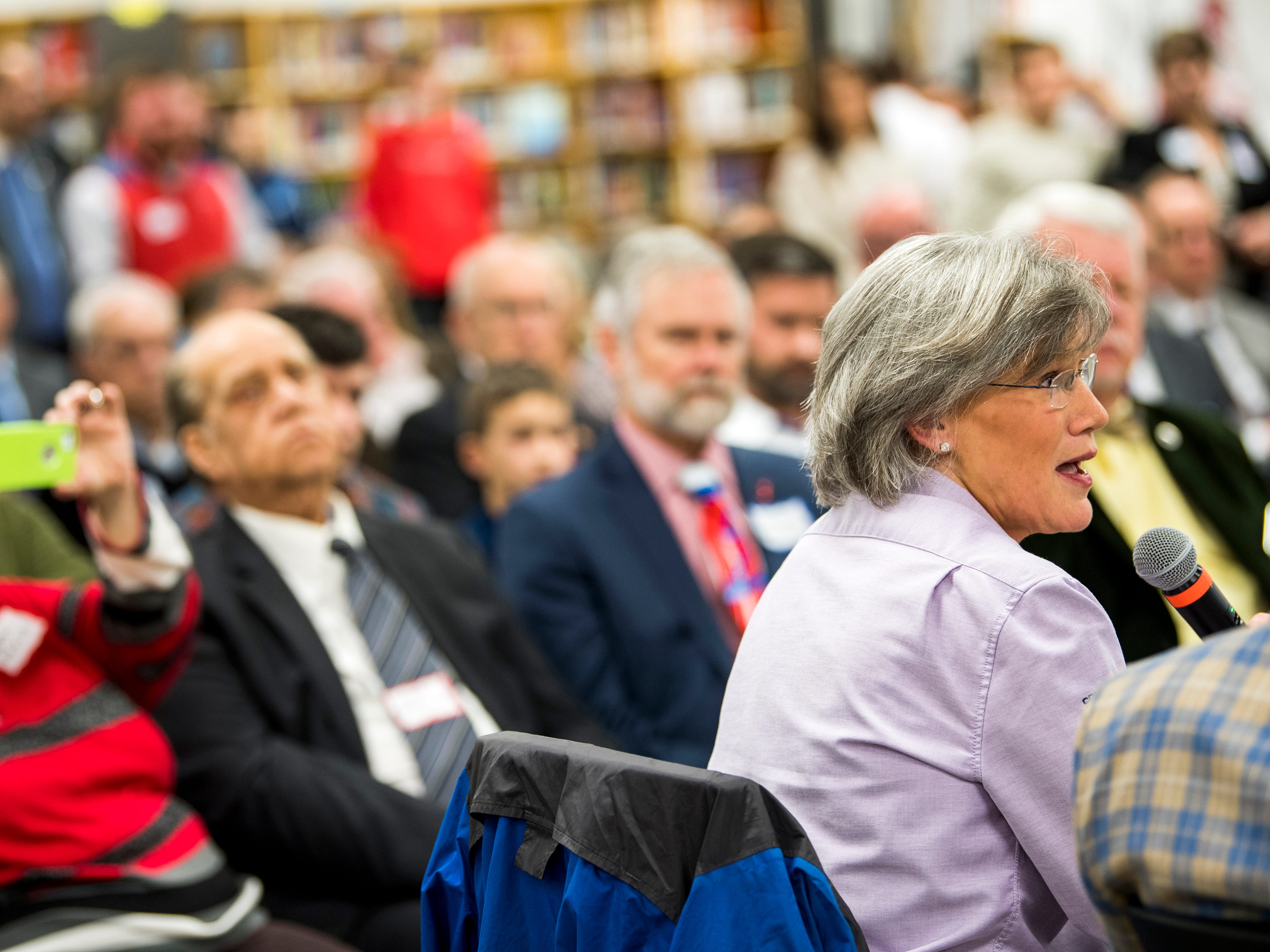 Shoffner Kalhoffat's Kathy Crookshanks, bottom right, asks a question during a roundtable event at South-Doyle High in South Knoxville on Friday, February 15, 2019.