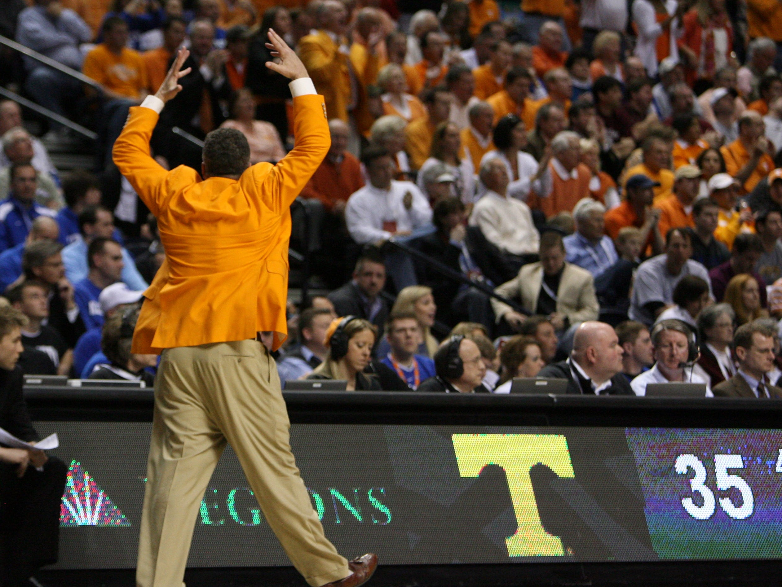 Head coach Bruce Pearl tries to rouse an outnumbered Tennessee fan base during game against Kentucky at the SEC Men's Basketball Tournament at Bridgestone Arena in Nashville Saturday, Mar. 13, 2010.