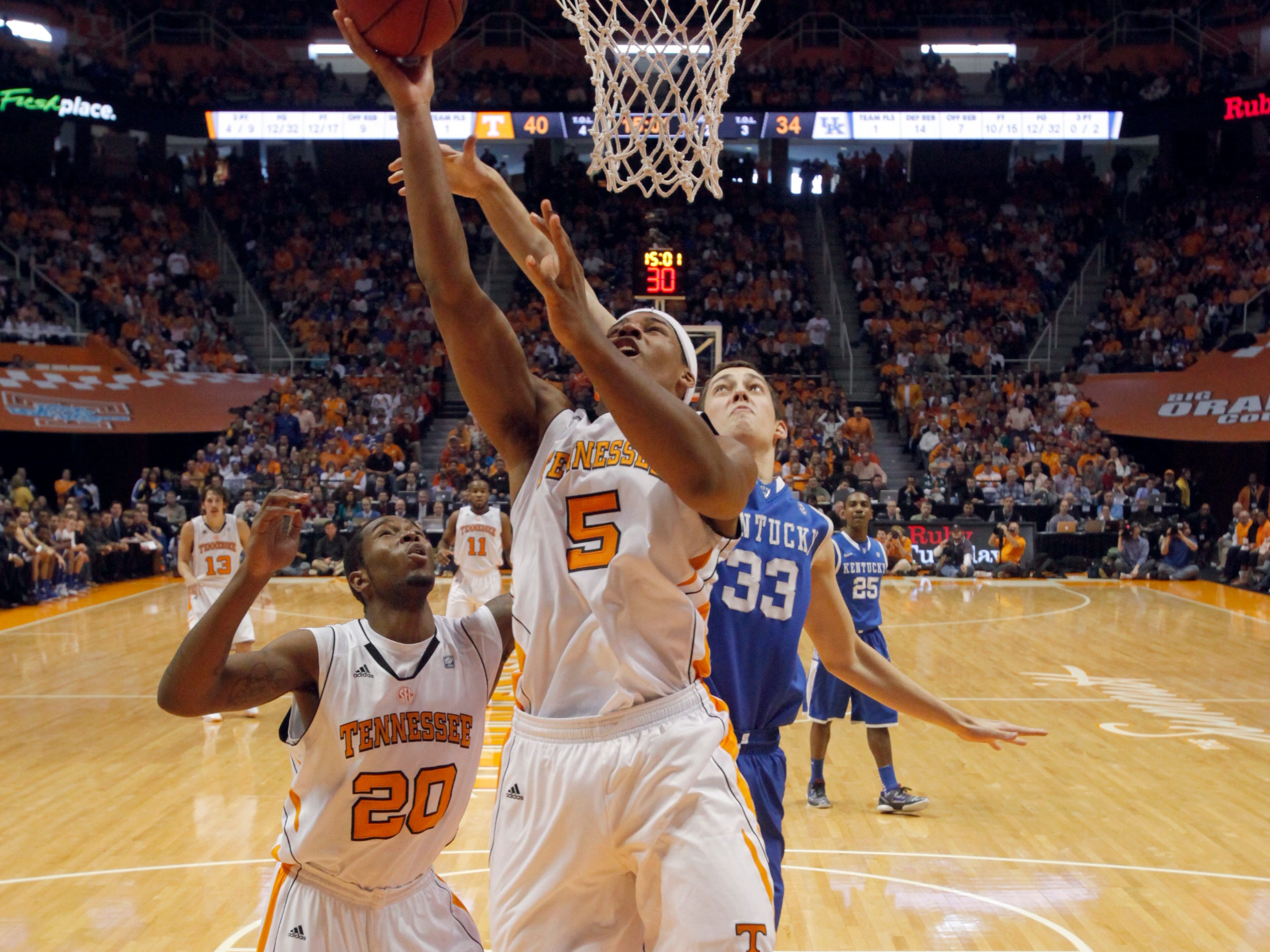 Tennessee forward Jarnell Stokes (5) goes in for a layup while Kentucky forward Kyle Wiltjer (33) defends at Thompson-Boling Arena in Saturday, Jan. 14, 2012.  Kentucky defeated Tennessee 65-62.