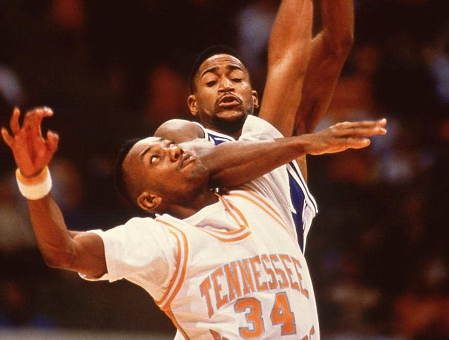 UT's Ronnie Reese and Kentucky's Reggie Hanson get tangled up during the jump ball that started the game in January 1990.