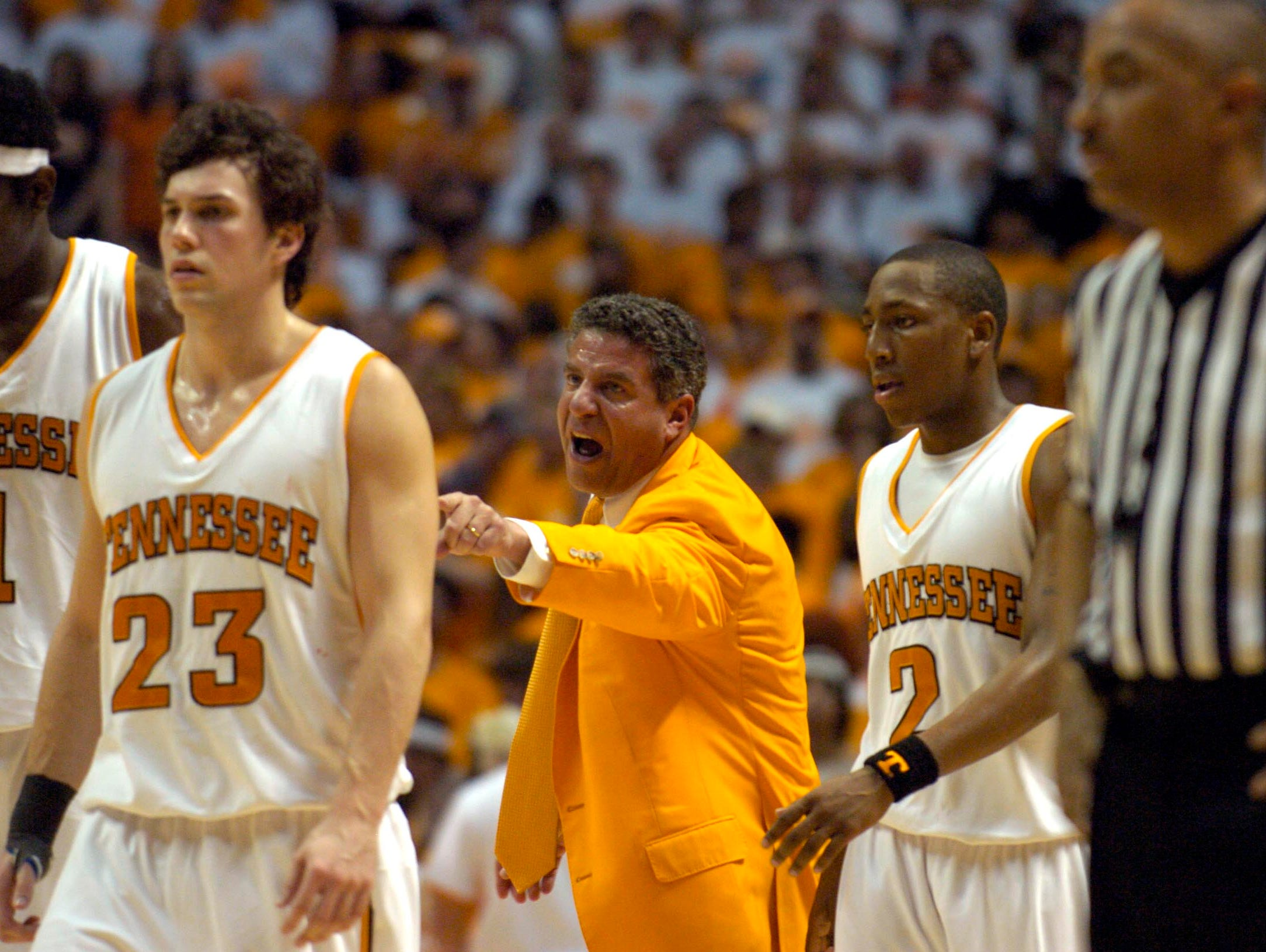 Tennessee head coach Bruce Pearl directs the players as they head back onto the court for play against Kentucky in March 2006. The Volunteers lost their second home game of the season 80-78.
