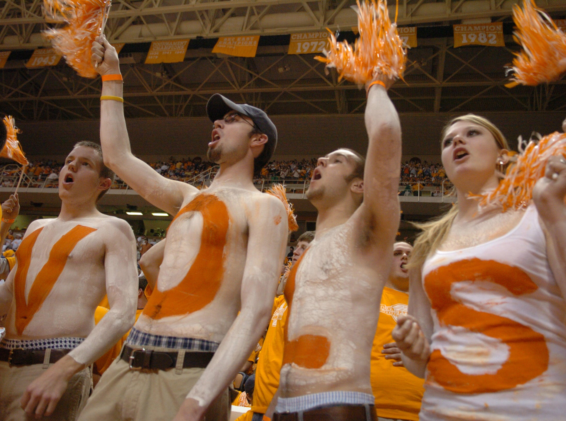 UT students, from left, Daniel Edmunds, 21, Blake Rust, 20, Jonathan Harris, 21, Mimi Slagle, 18, cheer on the Vols as they play Kentucky at Thompson Boling Arena in March 2006.