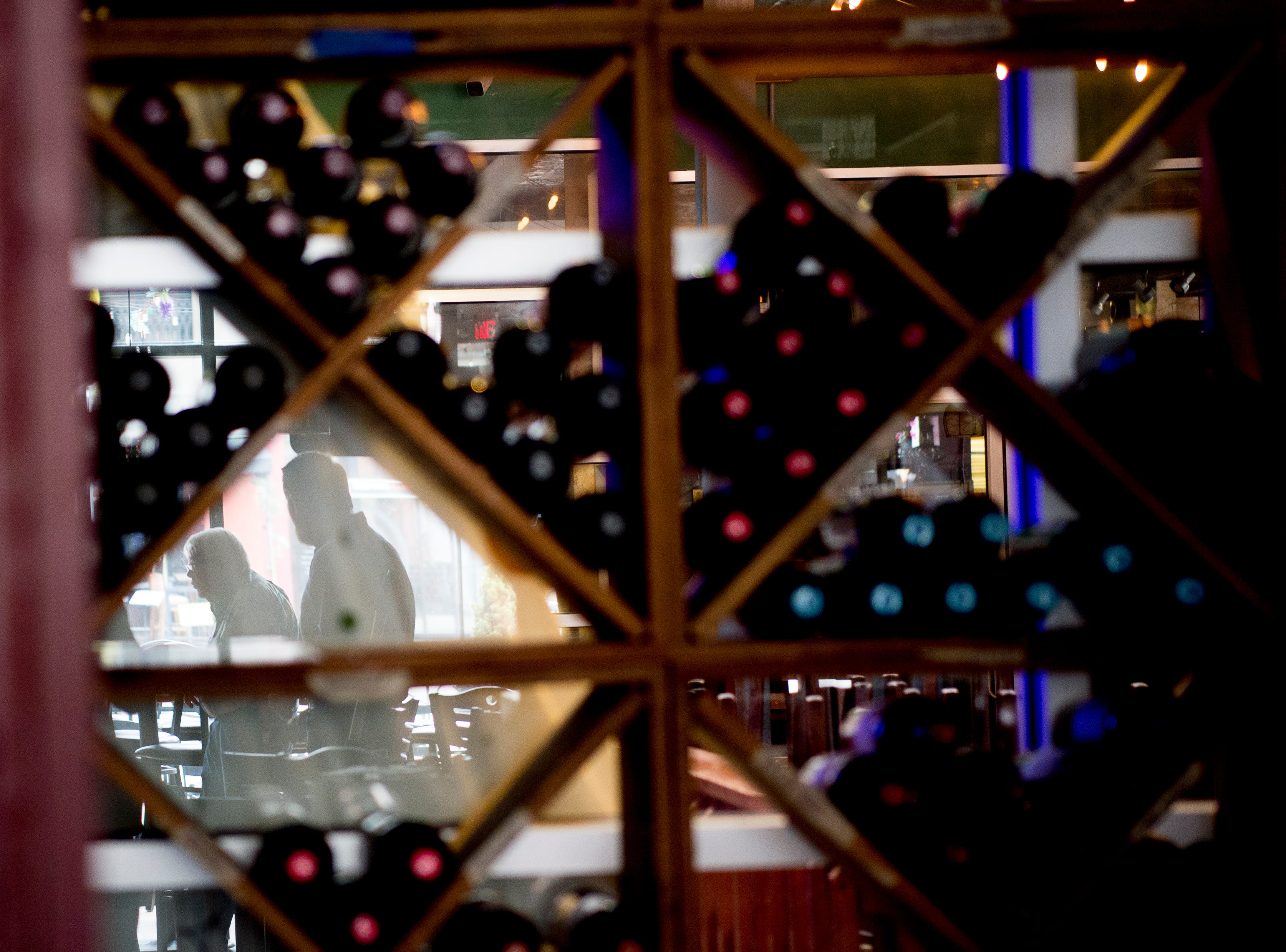Wine sits on shelves in the back area of the bar in Uncorked in Knoxville, Tennessee on Friday, February 15, 2019. Owner Scott West is replacing Uncorked with The Lost Tavern, a true crime-themed bar featuring upscale bar food, music from the 1940s in a dim, intimate setting.