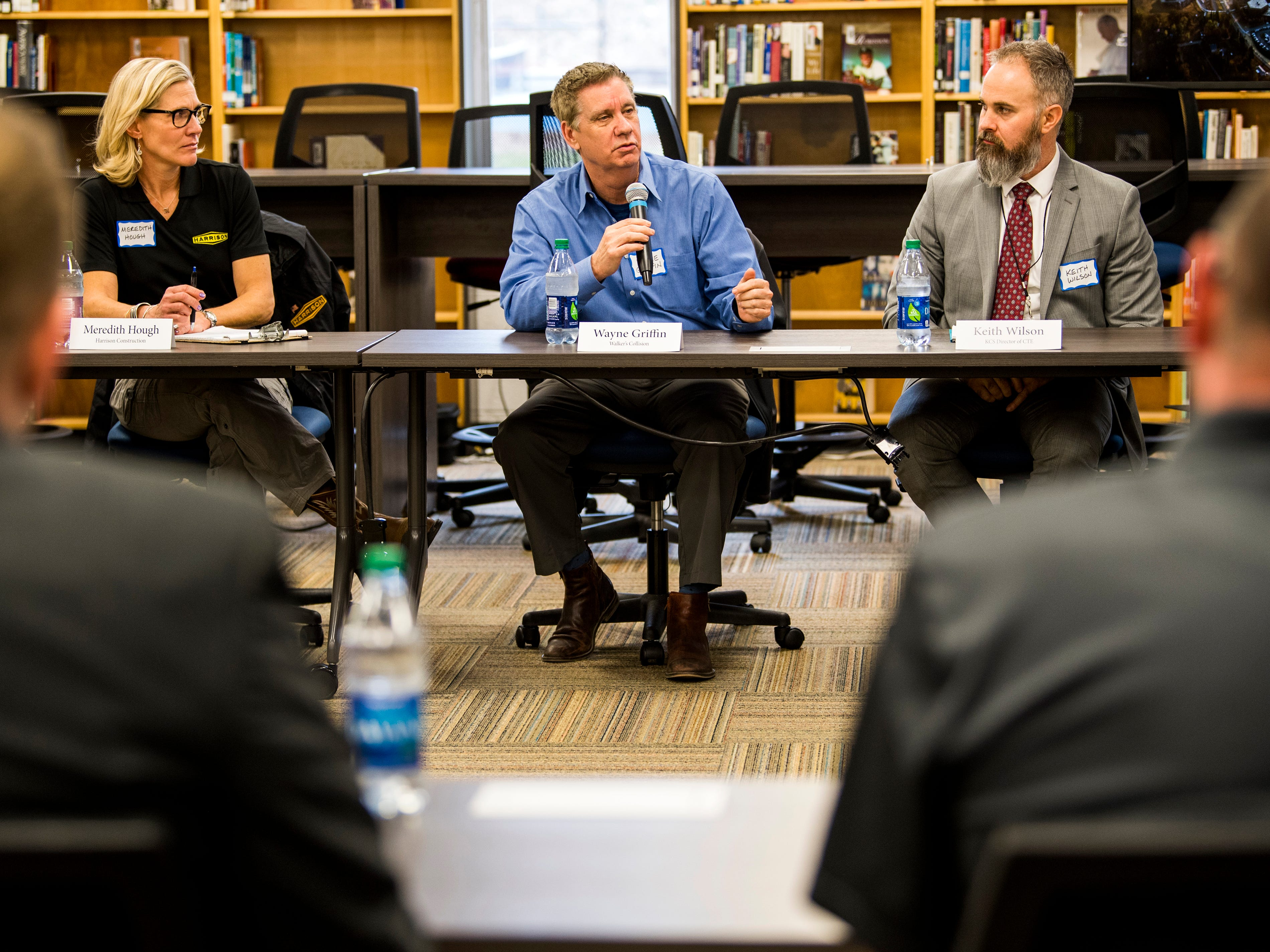 Walker's Collision's Wayne Griffin, center, asks a question during a roundtable event at South-Doyle High in South Knoxville on Friday, February 15, 2019.