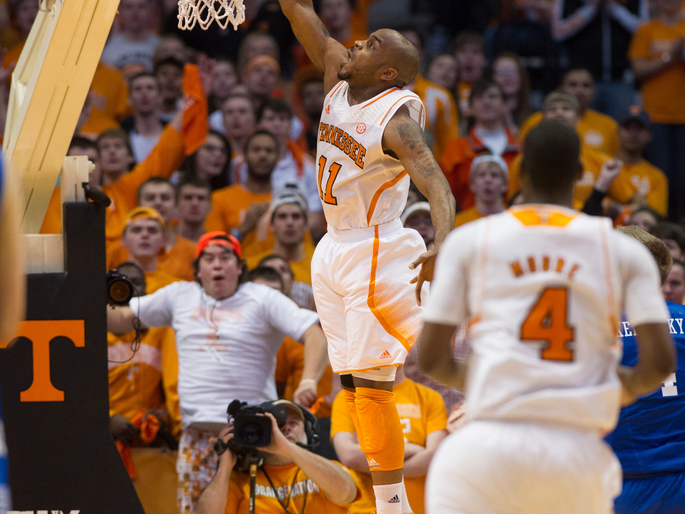 Tennessee guard Trae Golden (11) shoots a layup on a breakaway play during the second half against Kentucky at Thompson-Boling Arena Saturday, Feb. 16, 2013. Tennessee won 88-58 over Kentucky.