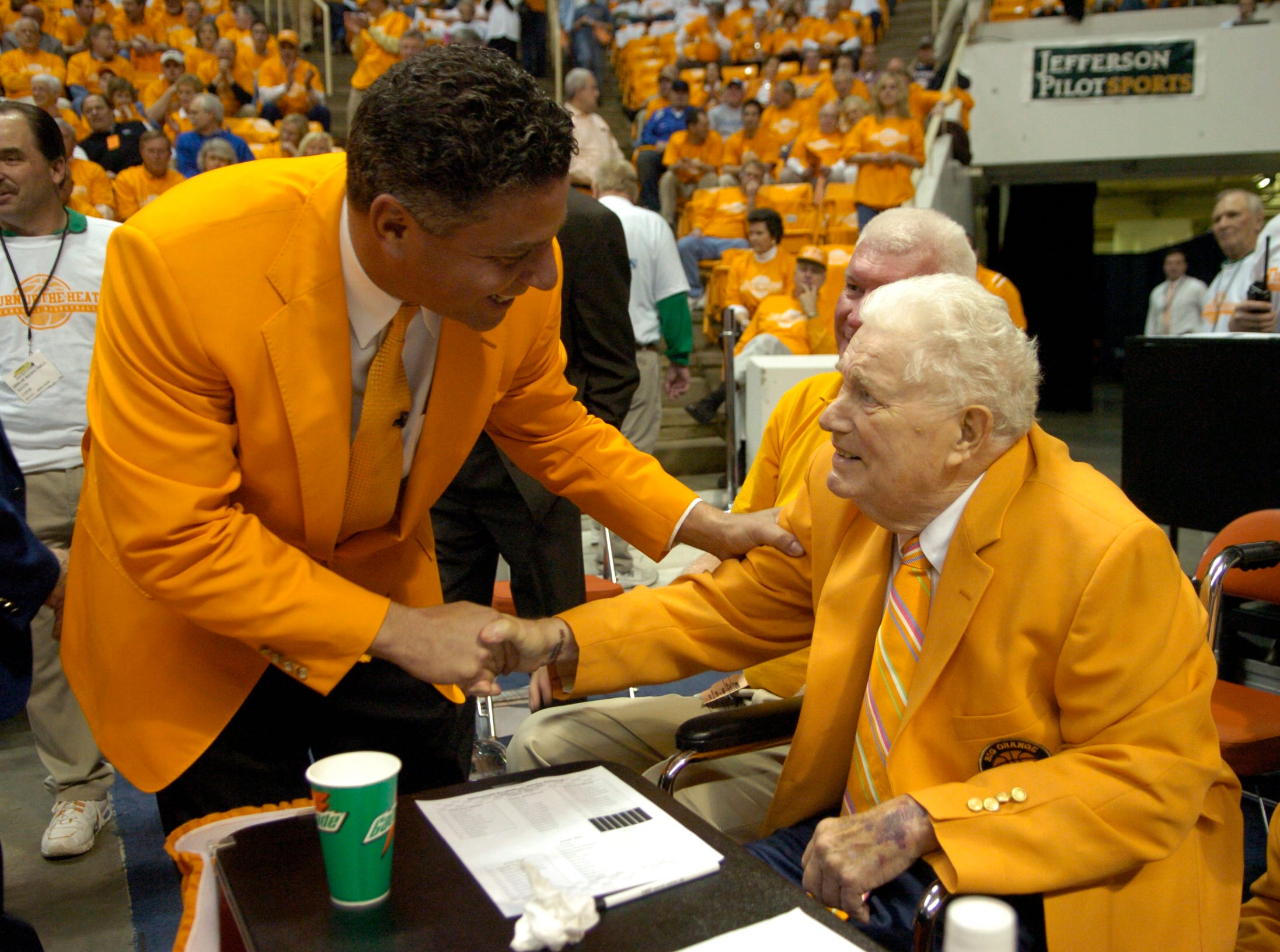 Tennessee head coach Bruce Pearl greets former head coach Ray Mears before the game against Kentucky in March 2006.