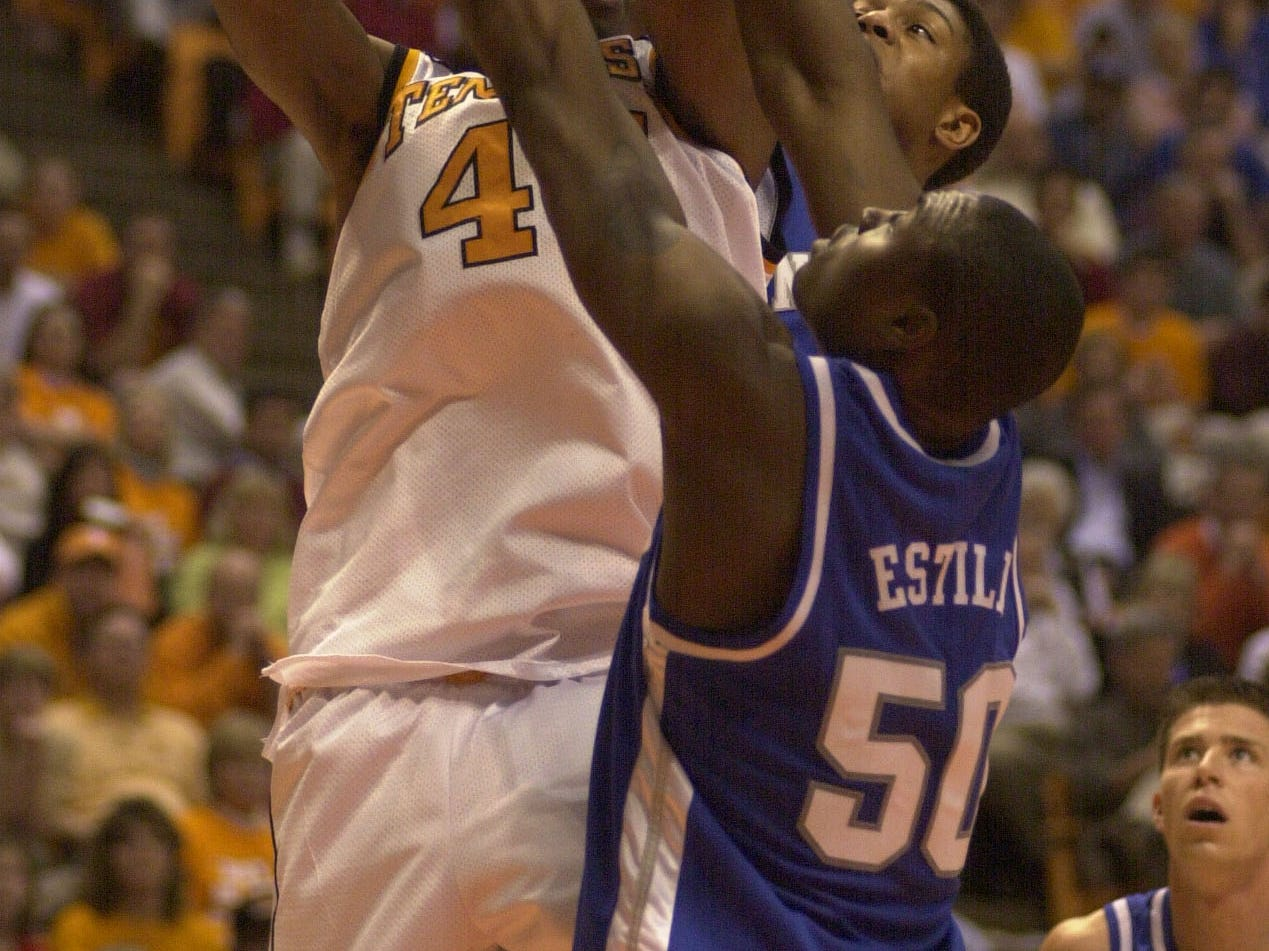 Tennessee's Isiah Victor gets his shot blocked by Kentucky's Marvin Stone and Marquis Estill during the Vols' 103-95 loss in February 2001.