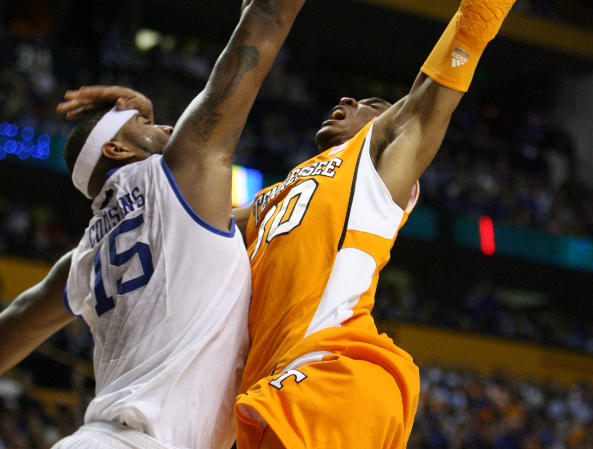 Tennessee's J.P. Prince tries to shoot over Kentucky's DeMarcus Cousins during the SEC Men's Basketball Tournament at Bridgestone Arena in Nashville Saturday, Mar. 13, 2010.  Prince scored 6 points for the Vols.
