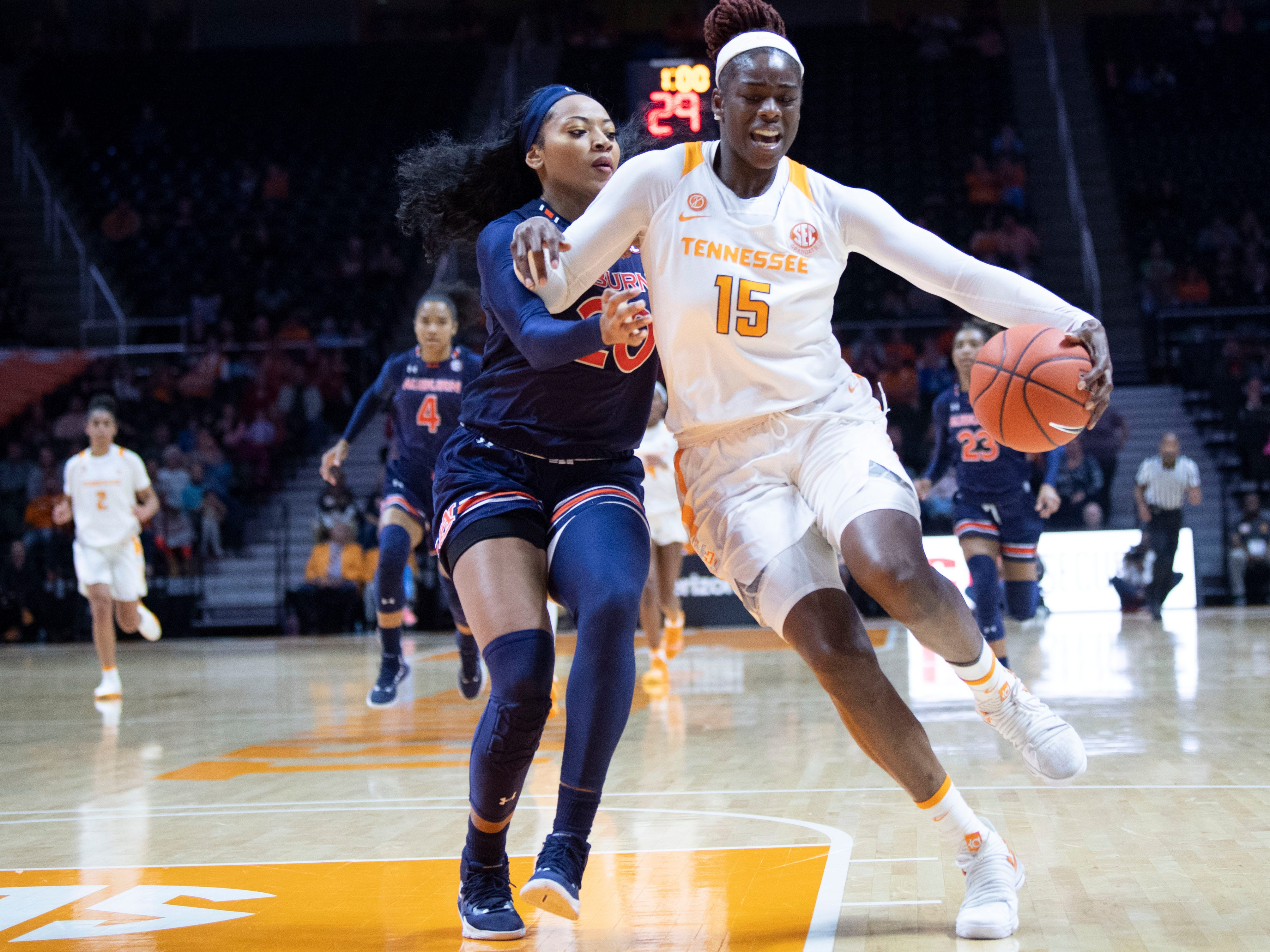Tennessee's Cheridene Green (15) drives towards the basket while guarded by Auburn's Unique Thompson (20) on Thursday, February 14, 2019.