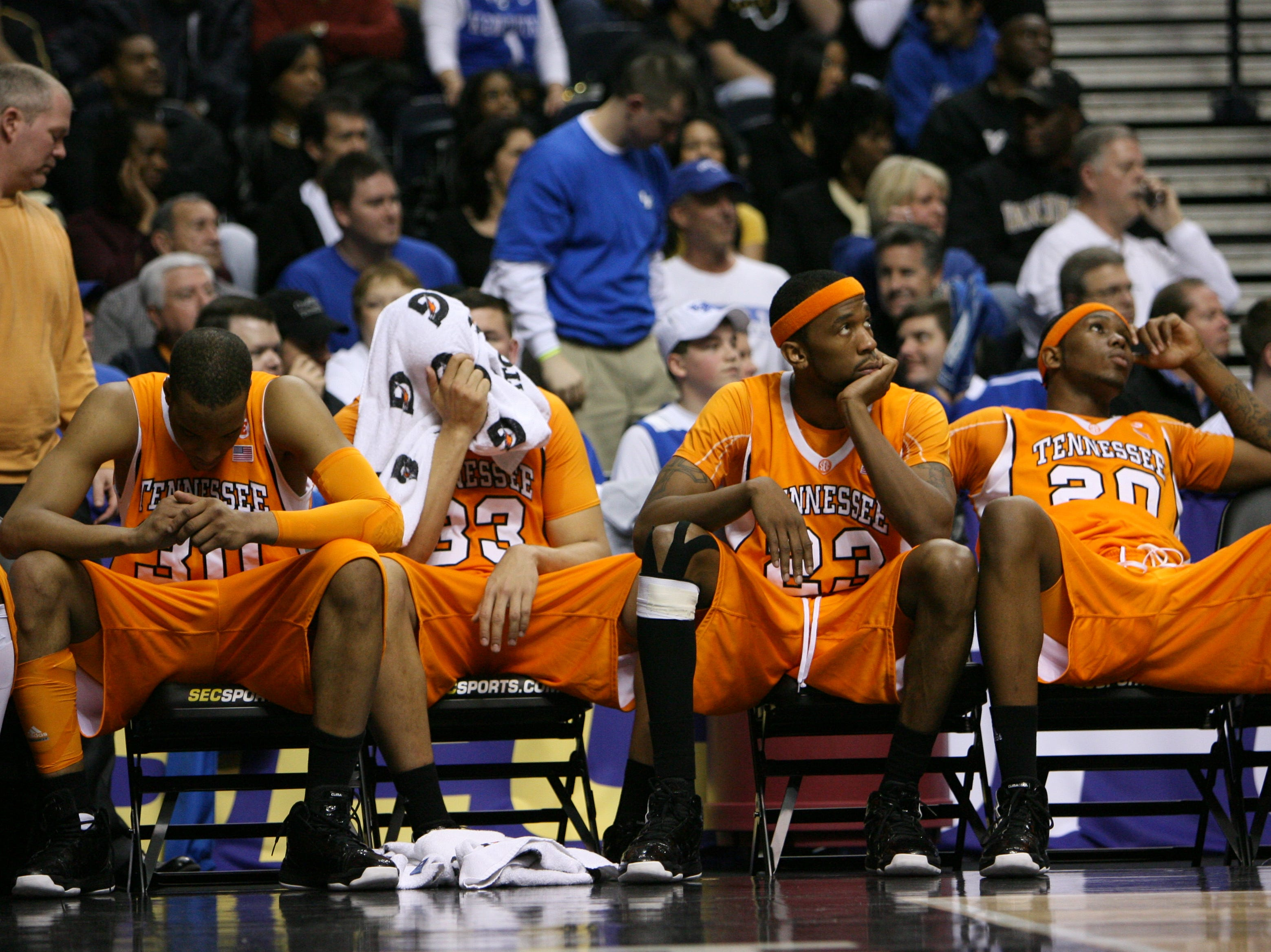 Tennessee's J.P. Prince, Brian Williams, Cameron Tatum and Kenny Hall, left to right, show their disappointment during the final seconds of the game against Kentucky at the SEC Men's Basketball Tournament at Bridgestone Arena in Nashville Saturday, Mar. 13, 2010.  Tennessee was defeated 74-45.