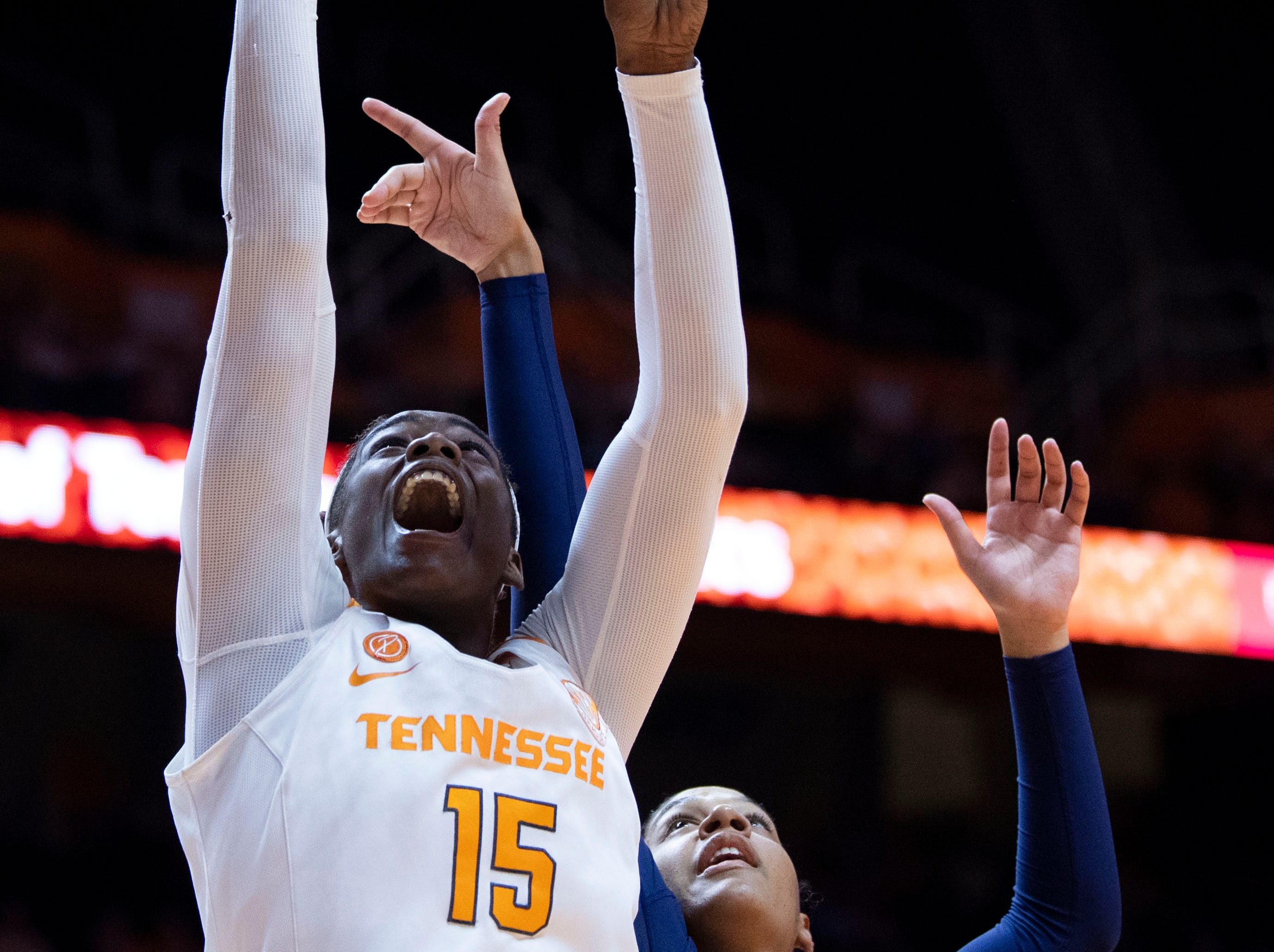 Tennessee's Cheridene Green (15) shoots and scores while guarded by Auburn's Erin Howard (24) on Thursday, February 14, 2019.